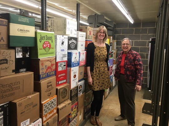 Faerber and Smethells in the basement of Lawson McGhee library, where over 150 volunteers work throughout the year to make the annual used book sale – and the Friends' many other endeavors – a success.