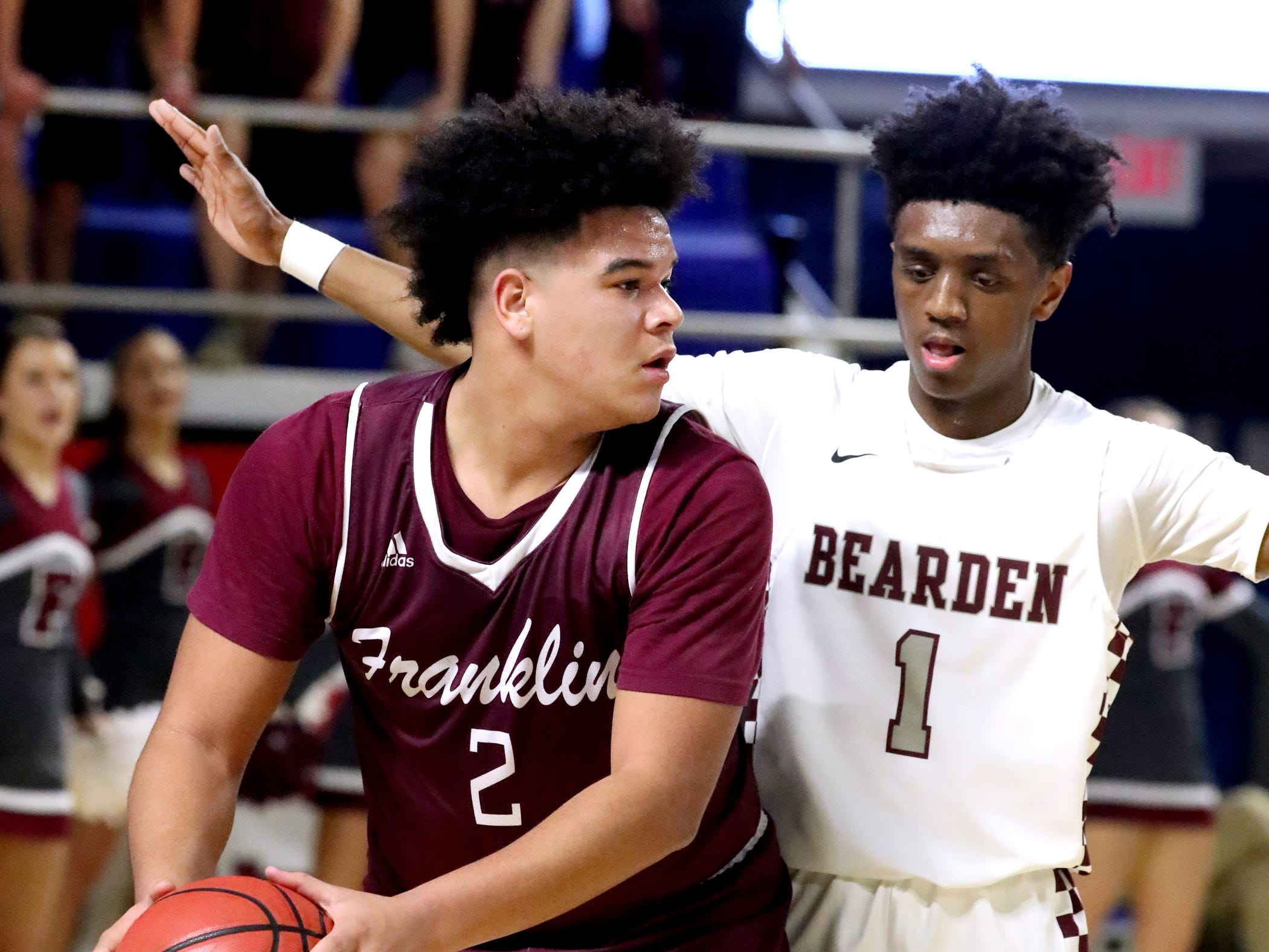 Franklin's Ahsharri Haynesworth (2) looks for a player to pass to as Bearden's Trent Stephney (1) guards him during the quarterfinal round of the TSSAA Class AAA Boys State Tournament, on Wednesday, March 13, 2019, at Murphy Center in Murfreesboro, Tenn.