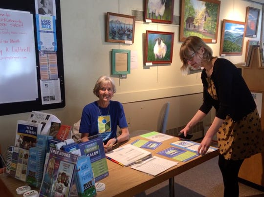 Sometimes being a Friend of the Library is a family affair. Mom Peggy and daughter Kristen Faerber get ready to open the Rothrock Used Book Shop for the day.