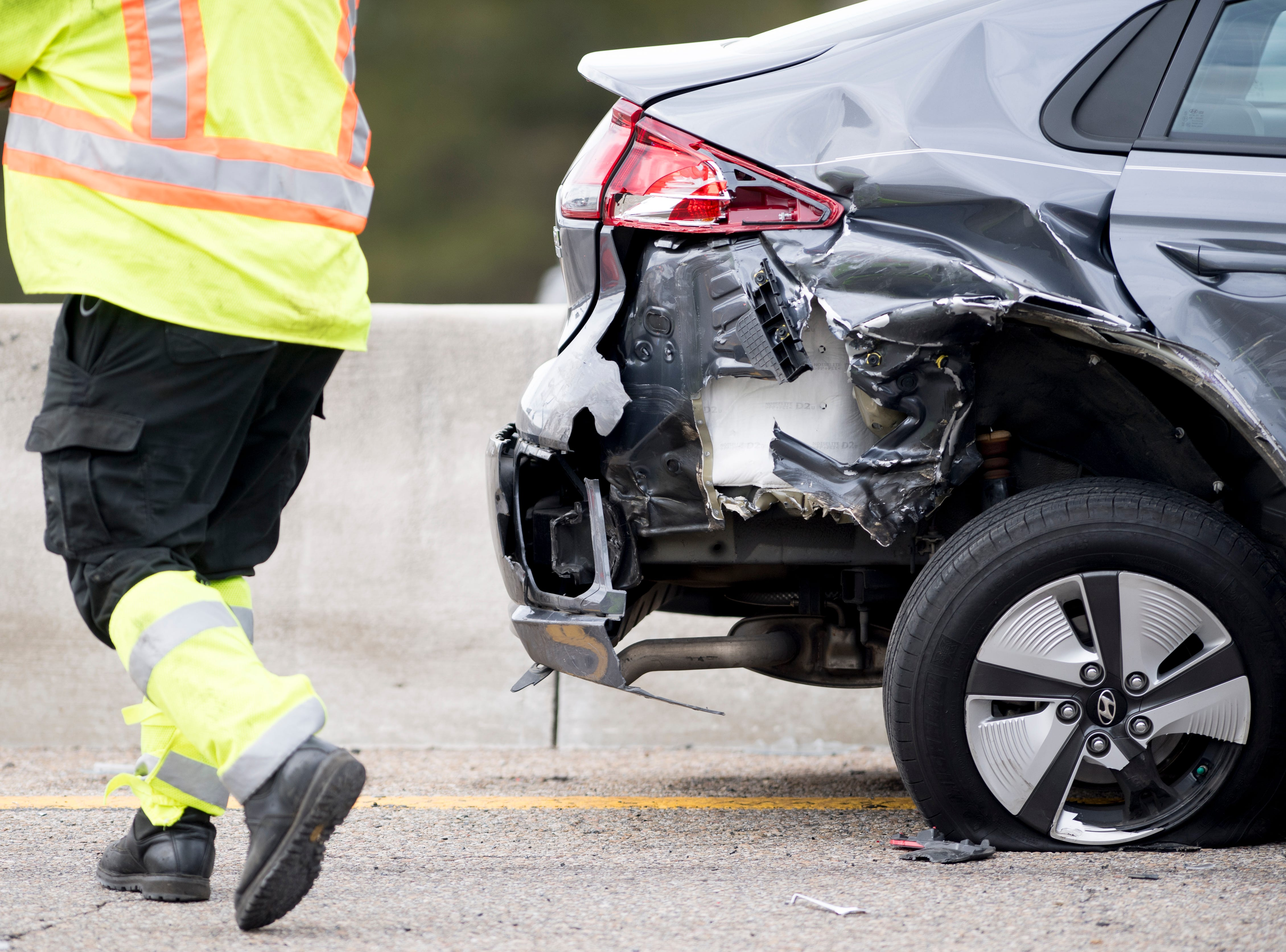 The back end of a Hyundai sedan is seen heavily damaged from a multiple vehicle pileup on I-75 northbound near the Callahan Drive exit in Knoxville, Tennessee on Thursday, March 14, 2019. The crash sent several to the hospital and backed up traffic to the I-640 interchange.
