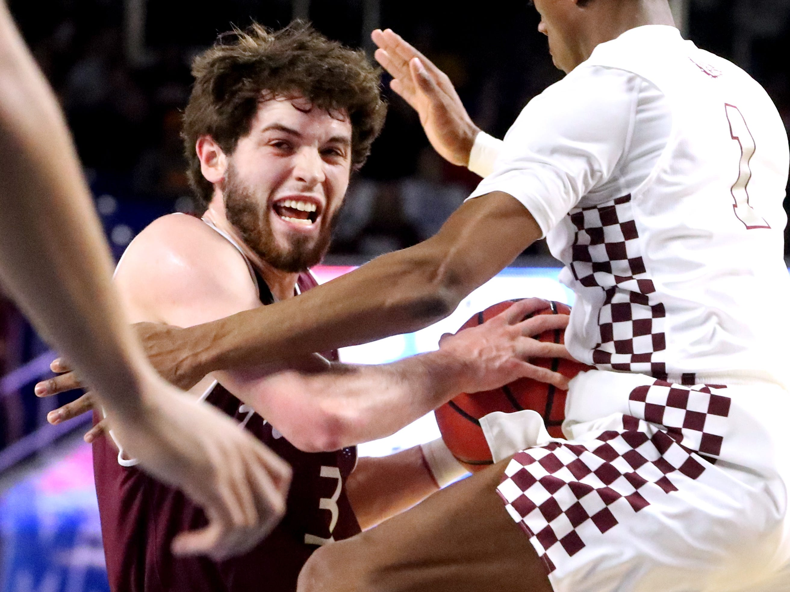 Franklin's Reese Glover (3) tries to get by Bearden's Trent Stephney (1) during the quarterfinal round of the TSSAA Class AAA Boys State Tournament, on Wednesday, March 13, 2019, at Murphy Center in Murfreesboro, Tenn.