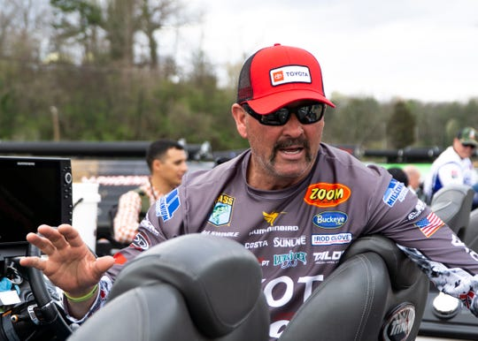 Gerald Swindle talks to an interviewer at Chilhowee Park the day before the start of the first Bassmaster Classic to be held in Knoxville this weekend.