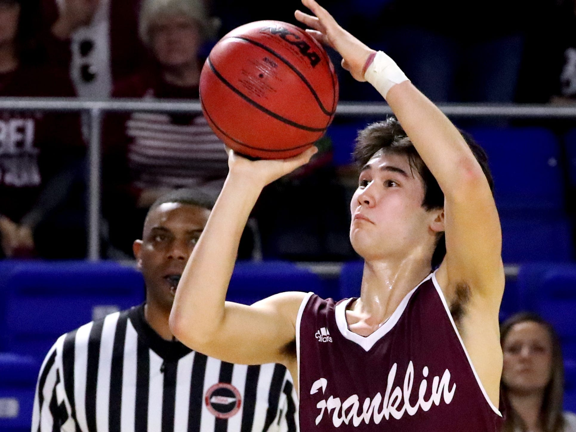 Franklin's Reed Kemp (4) shoots the ball during the quarterfinal round of the TSSAA Class AAA Boys State Tournament against Bearden, on Wednesday, March 13, 2019, at Murphy Center in Murfreesboro, Tenn.