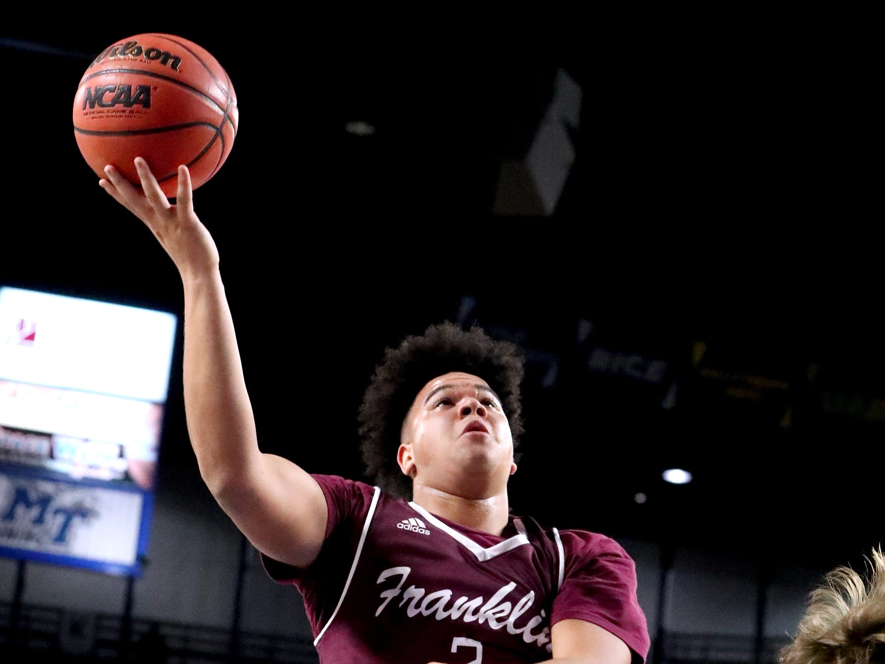 Franklin's Ahsharri Haynesworth (2) shoots the ball as Bearden's Kordell Kah (24) falls to the floor during the quarterfinal round of the TSSAA Class AAA Boys State Tournament, on Wednesday, March 13, 2019, at Murphy Center in Murfreesboro, Tenn.