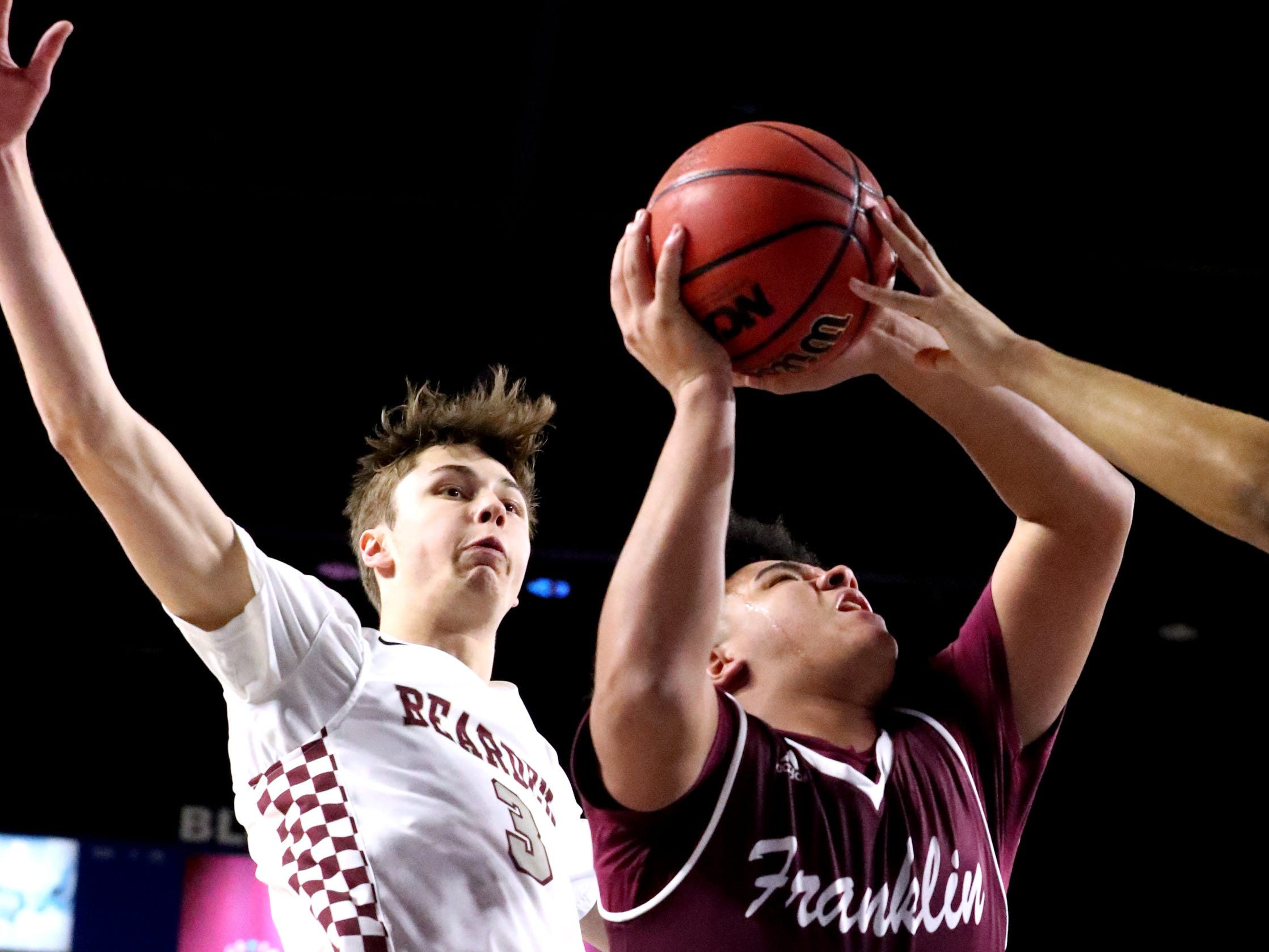 Franklin's Ahsharri Haynesworth (2) shoots between Bearden's Drew Pember (3) and  Shamarcus Brown (35) during the quarterfinal round of the TSSAA Class AAA Boys State Tournament, on Wednesday, March 13, 2019, at Murphy Center in Murfreesboro, Tenn.