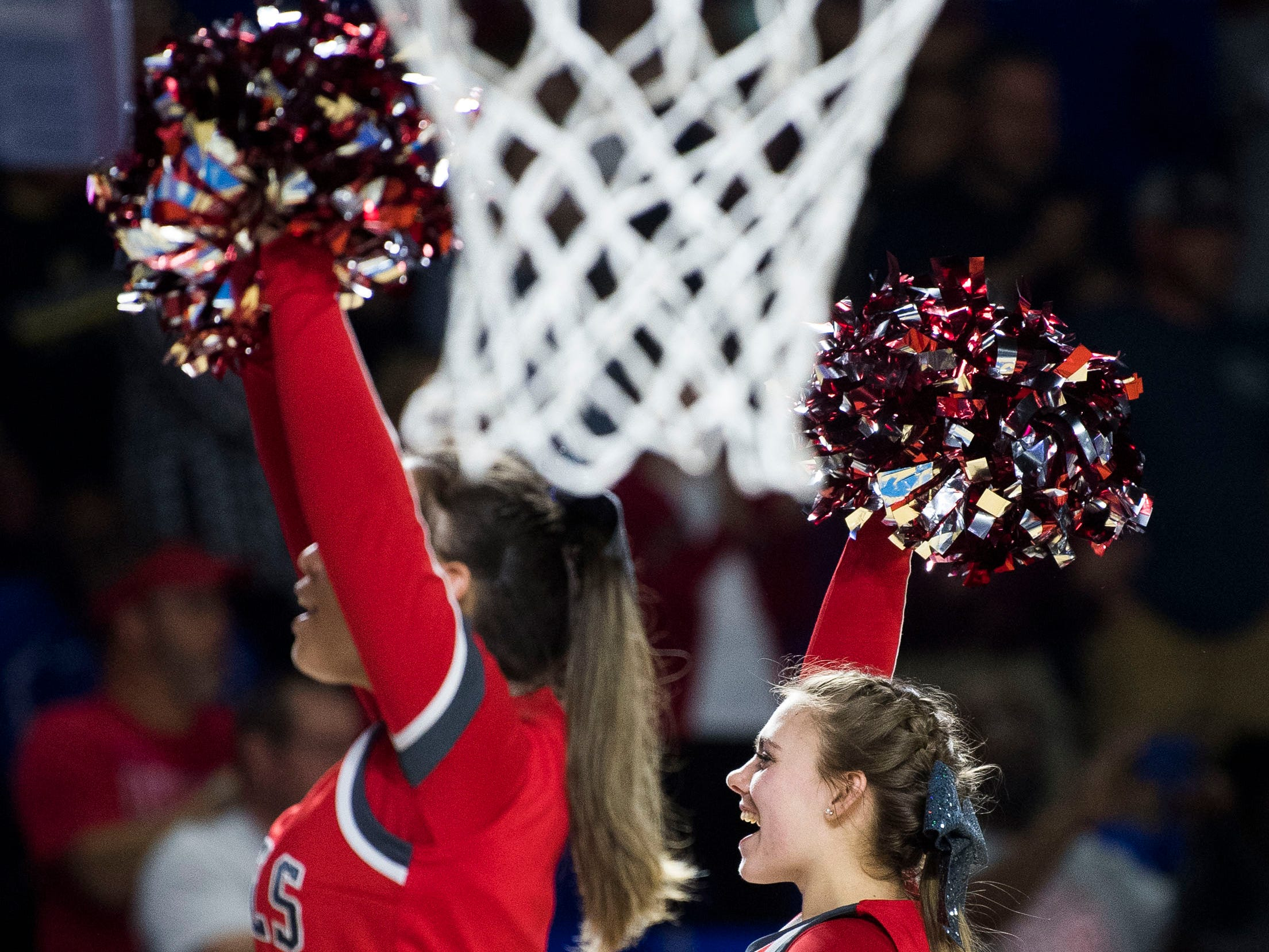 McKenzie cheerleaders cheer before a TSSAA A state quarterfinal game between University School and McKenzie at the Murphy Center in Murfreesboro, Thursday, March 14, 2019.