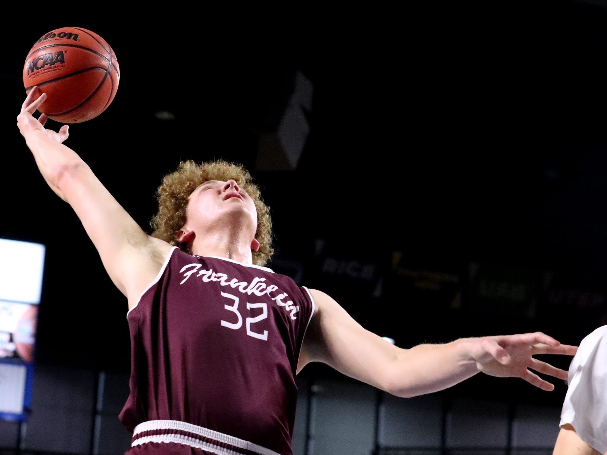 Franklin's Matthew Thurman (32) grabs a rebound during the quarterfinal round of the TSSAA Class AAA Boys State Tournament Bearden, on Wednesday, March 13, 2019, at Murphy Center in Murfreesboro, Tenn.