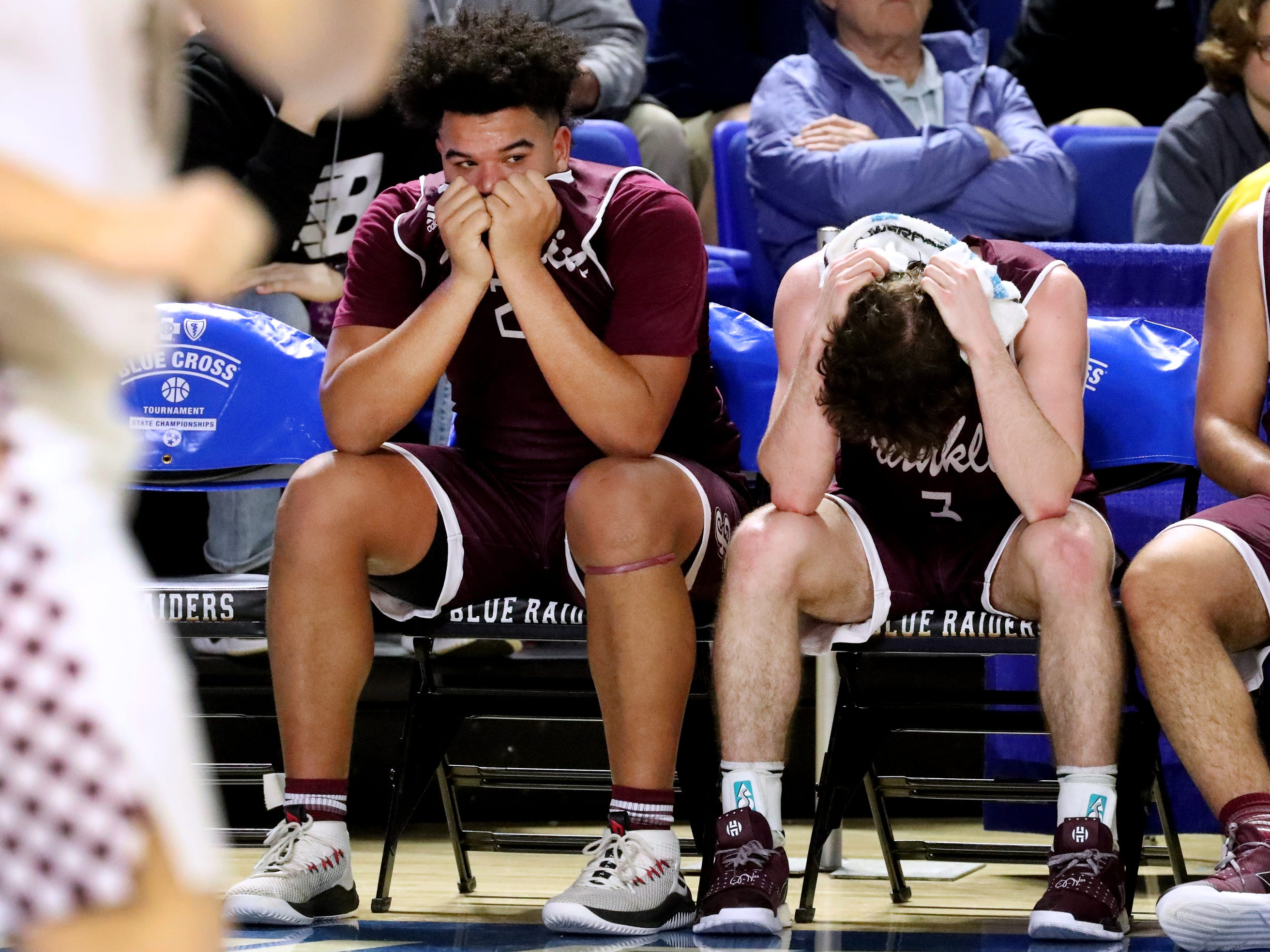 Franklin High School seniors Ahsharri Haynesworth (2), left and Reese Glover (3),right react to losing during the final moments in the quarterfinal round of the TSSAA Class AAA Boys State Tournament against Bearden, on Wednesday, March 13, 2019, at Murphy Center in Murfreesboro, Tenn.