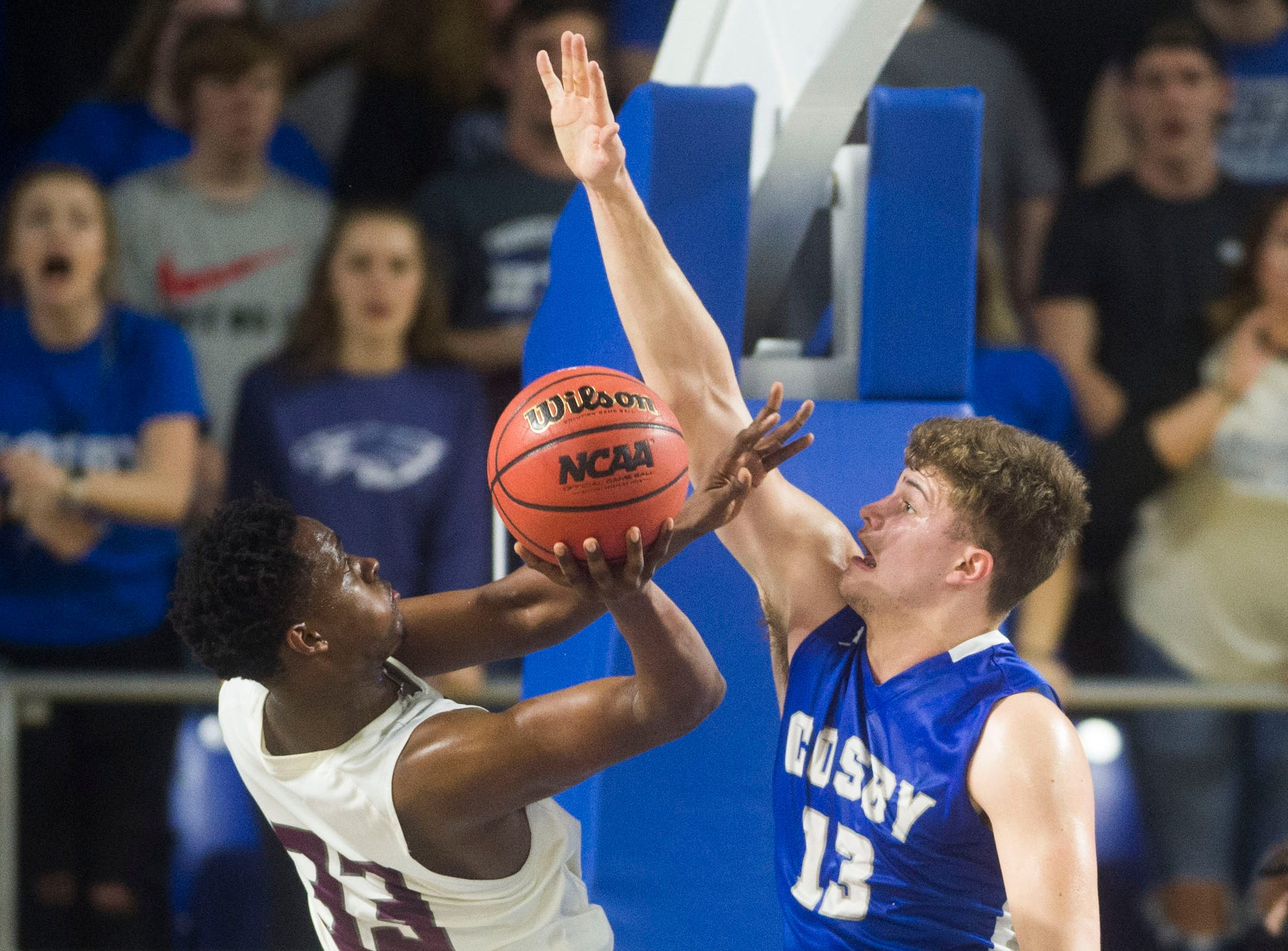 Cosby's Austin McKeehan (13) defends the ball during a TSSAA A state quarterfinal game between Eagleville and Cosby at the Murphy Center in Murfreesboro, Thursday, March 14, 2019.