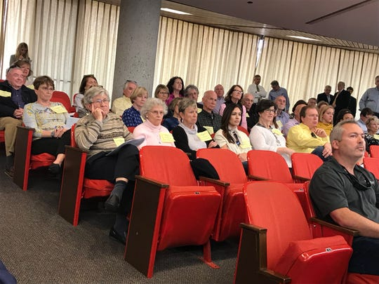 """Opponents of the proposed Gables at Westmoreland subdivision wore """"Preserve Our Neighborhood"""" signs at the Knoxville-Knox County Planning meeting Thursday, March 14, 2019."""