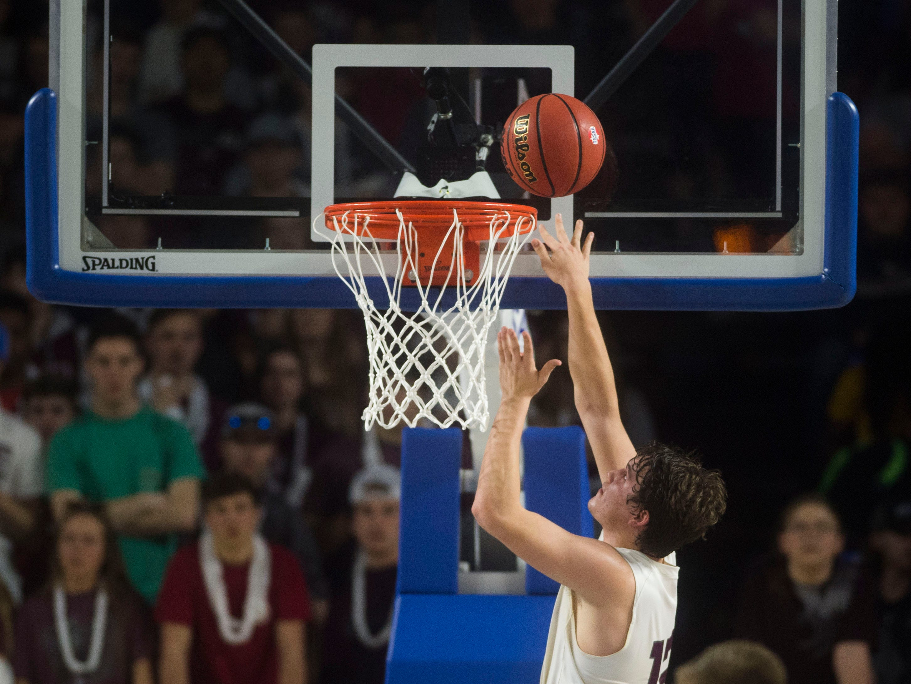 Eagleville's Luke Parish (13) attempts a rebound unsuccessfully during a TSSAA A state quarterfinal game between Eagleville and Cosby at the Murphy Center in Murfreesboro, Thursday, March 14, 2019. Eagleville defeated Cosby 66-55.