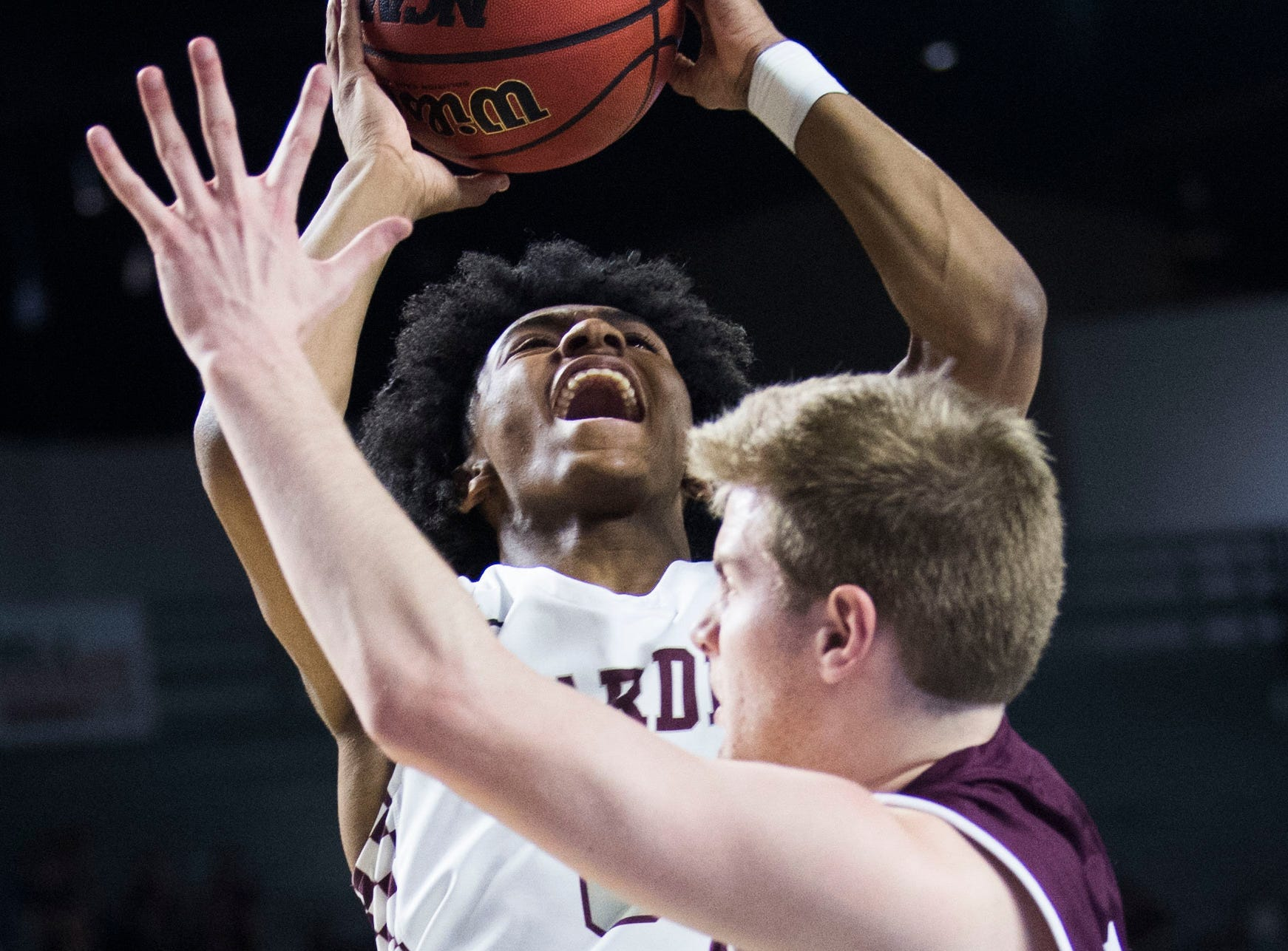 Bearden's Ques Glover (0) takes a shot during a TSSAA AAA state quarterfinal game between Bearden and Franklin at the Murphy Center in Murfreesboro, Wednesday, March 13, 2019.