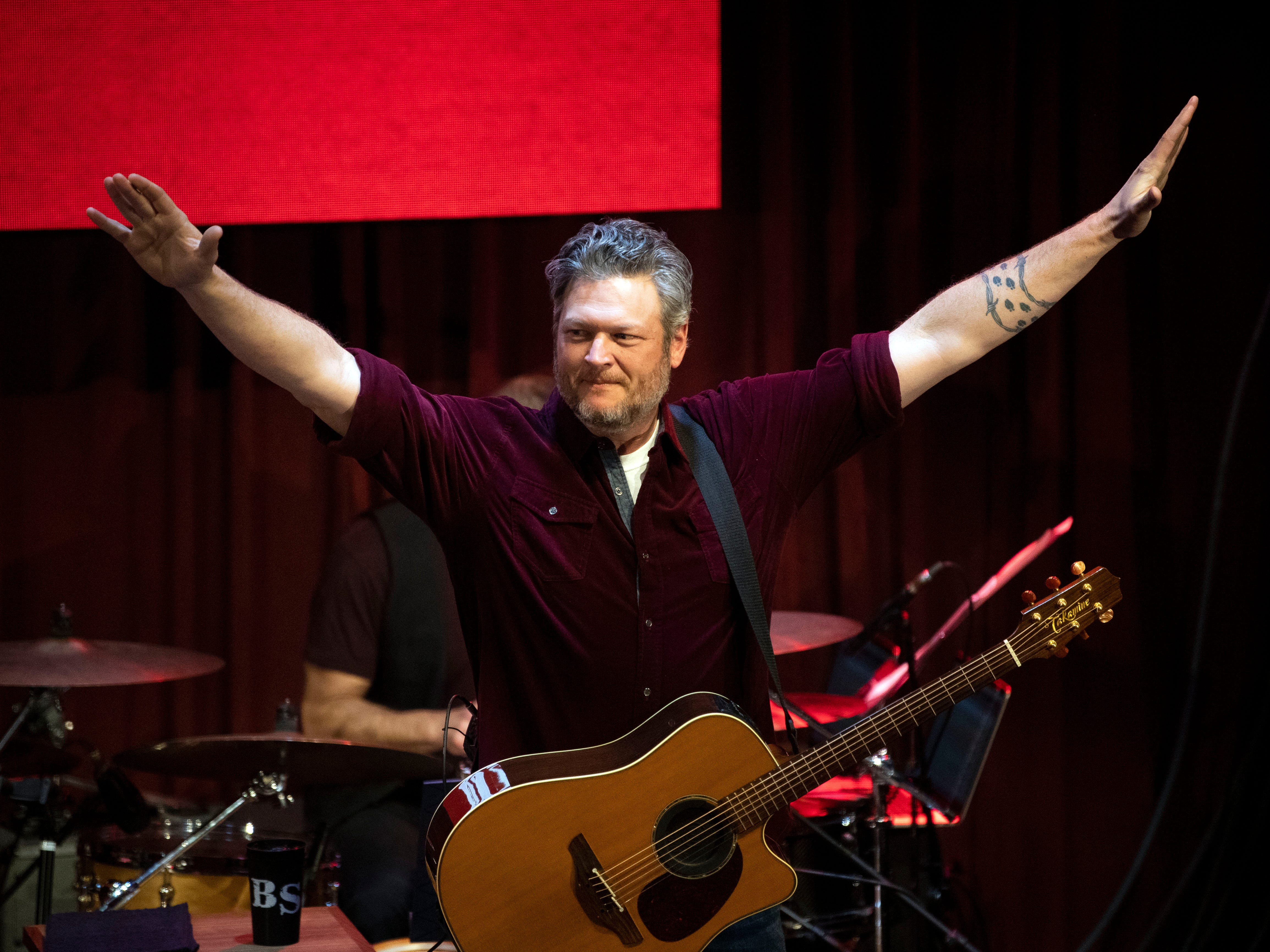 Blake Shelton greets the crowd as he takes the stage at the grand opening celebration of Ole Red Gatlinburg on Wednesday, March 13, 2019.