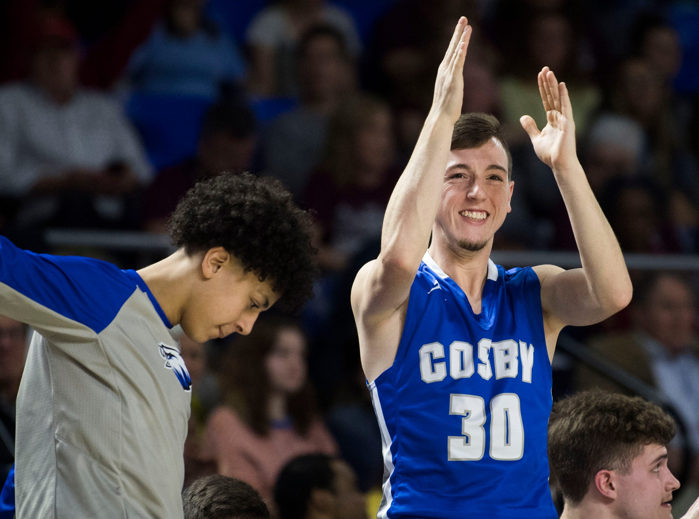 Cosby's Chase Williamson (30) celebrates on the bench during a TSSAA A state quarterfinal game between Eagleville and Cosby at the Murphy Center in Murfreesboro, Thursday, March 14, 2019. Eagleville defeated Cosby 66-55.