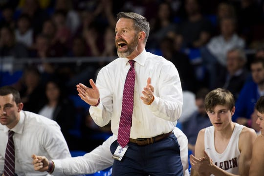 Bearden's head coach Jeremy Parrott coaches on the sidelines during a TSSAA AAA state quarterfinal game between Bearden and Franklin at the Murphy Center in Murfreesboro, Wednesday, March 13, 2019. Bearden defeated Franklin 76-46.