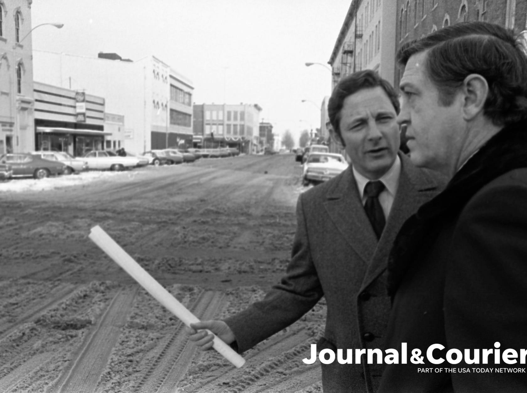 U.S Senator Birch Bayh discusses Railroad Relocation wiht Lafayette mayor Jim Riehle on Fifth Street. Photo taken Jan. 12, 1974.