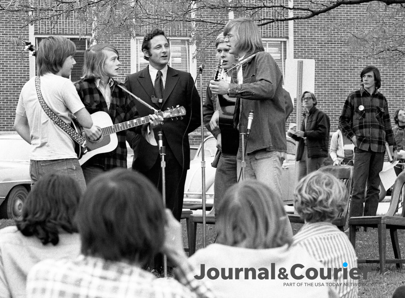 "Birch Bayh joins local folk sining group, Broken Finger, for a rendition of the song ""The Times They Are A-Changing."" Senetor Bayh was visiting Purdue University on a ""special mission"" to win last minute votes for Decmocrats George McGovern and Matt Welsh. Photo taken on November 6, 1972."