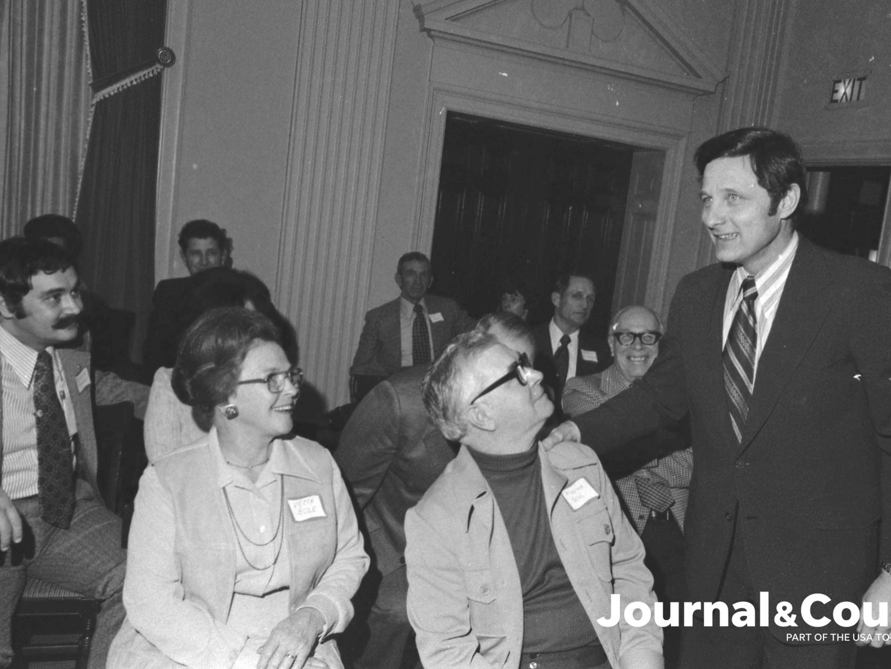 Sen. Birch Bayh greets Vesta and Maynard Bozeman at a program inducting him as a member of the Tippecanoe County Democratic Women's Organization. Photo taken Feb. 19, 1975.