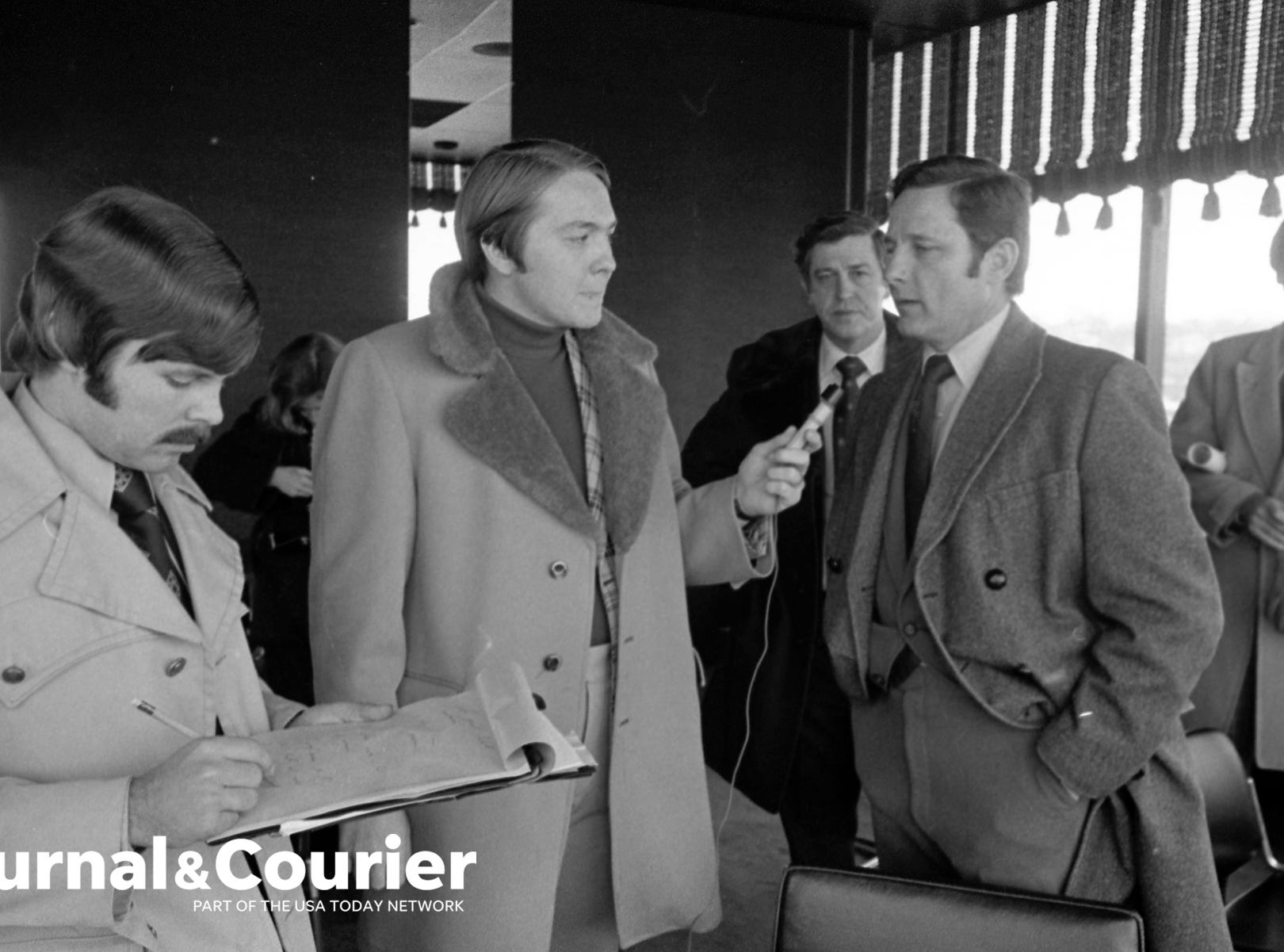Senator Birch Bahy met with local media in Lafayette to discuss plans for the city's Railroad Relocation project. At left is Lafayette Journal & Courier reporter John Norberg and in the background is Lafayette Mayor Jim Reihle. Photo taken Jan. 12, 1974.