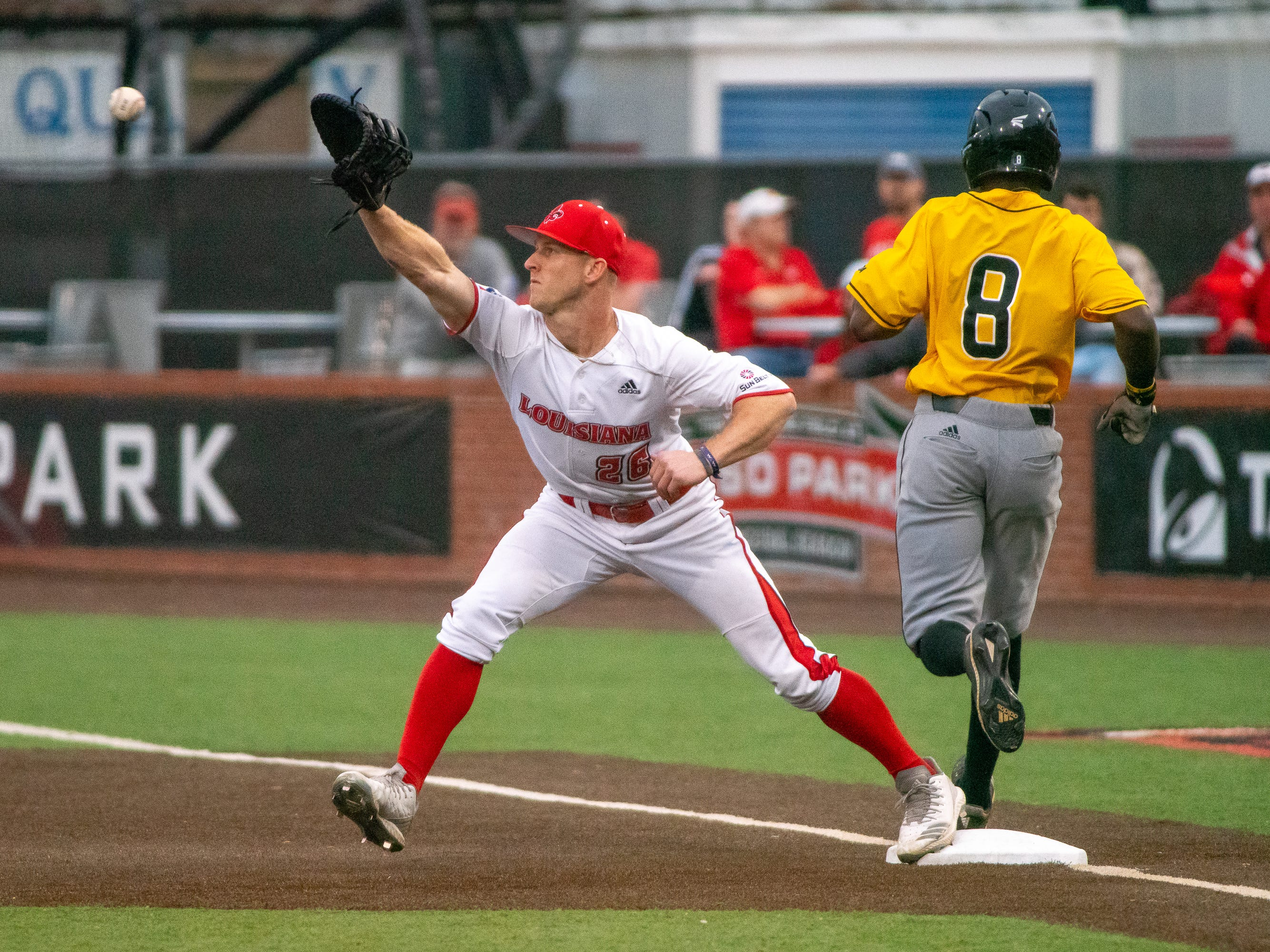"""UL's Daniel Lahare catches a late throw to first base as the Ragin' Cajuns take on the Southern Miss Golden Eagles at M.L. """"Tigue"""" Moore Field on Wednesday, March 13, 2019."""