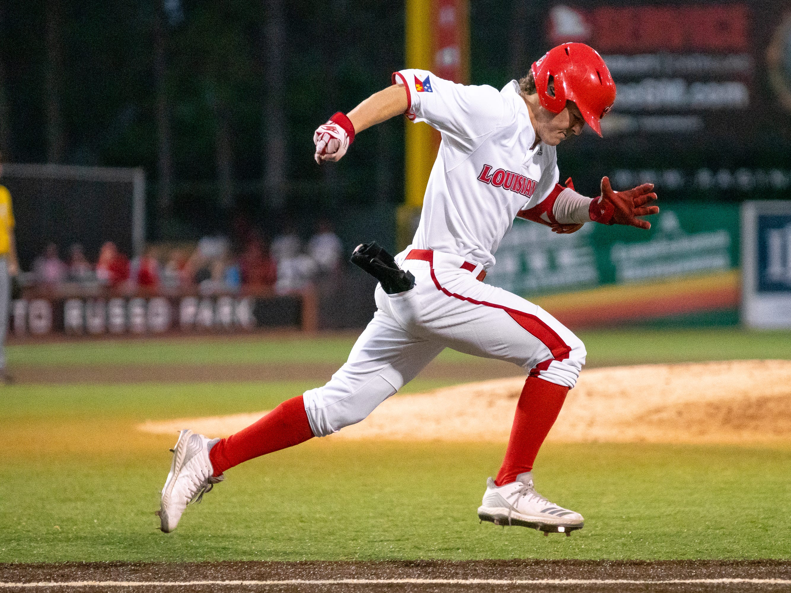 """UL's Hayden Cantrelle sprints to first base as the Ragin' Cajuns take on the Southern Miss Golden Eagles at M.L. """"Tigue"""" Moore Field on Wednesday, March 13, 2019."""