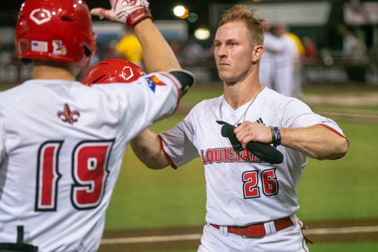 """UL's Daniel Lahare walks to the dugout after scoring a run for his team as the Ragin' Cajuns take on the Southern Miss Golden Eagles at M.L. """"Tigue"""" Moore Field on Wednesday, March 13, 2019."""