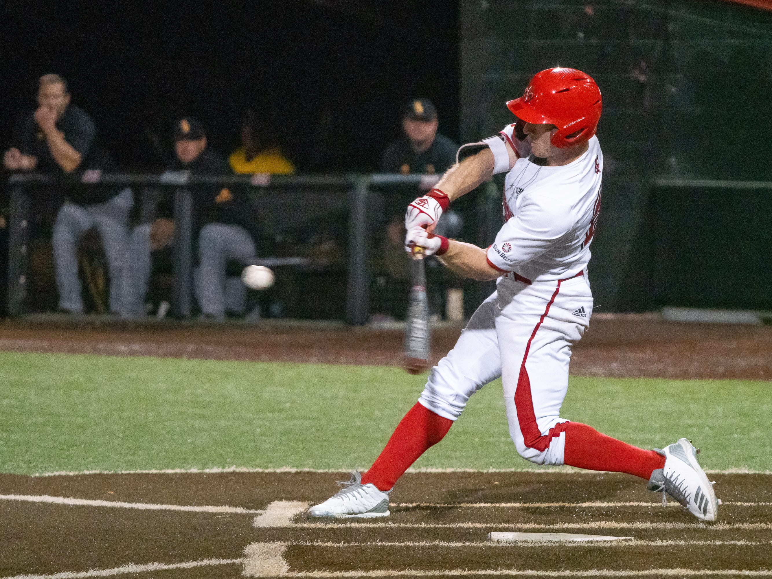 """UL's Daniel Lahare connects with the incoming pitch as the Ragin' Cajuns take on the Southern Miss Golden Eagles at M.L. """"Tigue"""" Moore Field on Wednesday, March 13, 2019."""