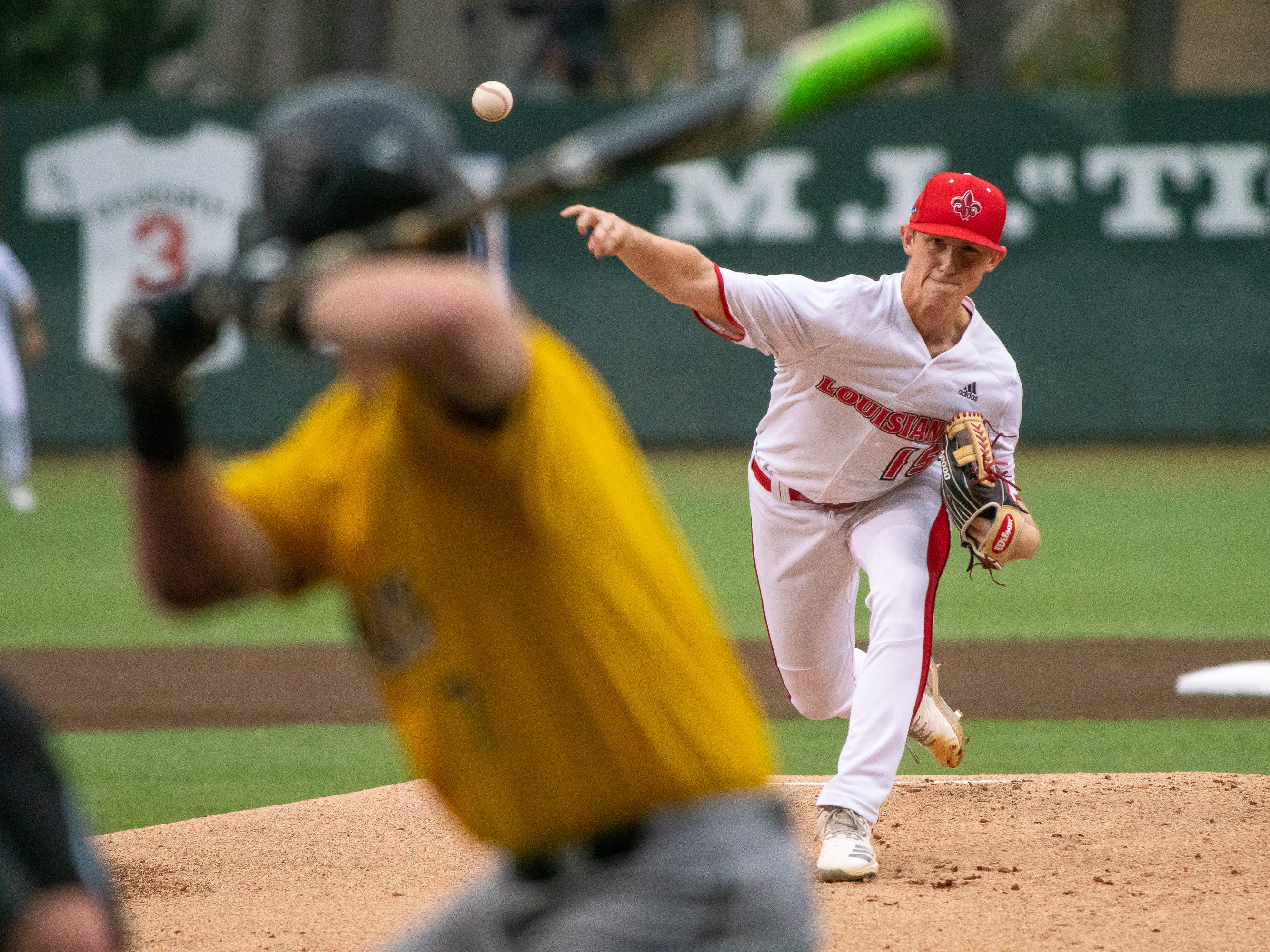 """UL's pitcher Jacob Schultz throws to the batter as the Ragin' Cajuns take on the Southern Miss Golden Eagles at M.L. """"Tigue"""" Moore Field on Wednesday, March 13, 2019."""