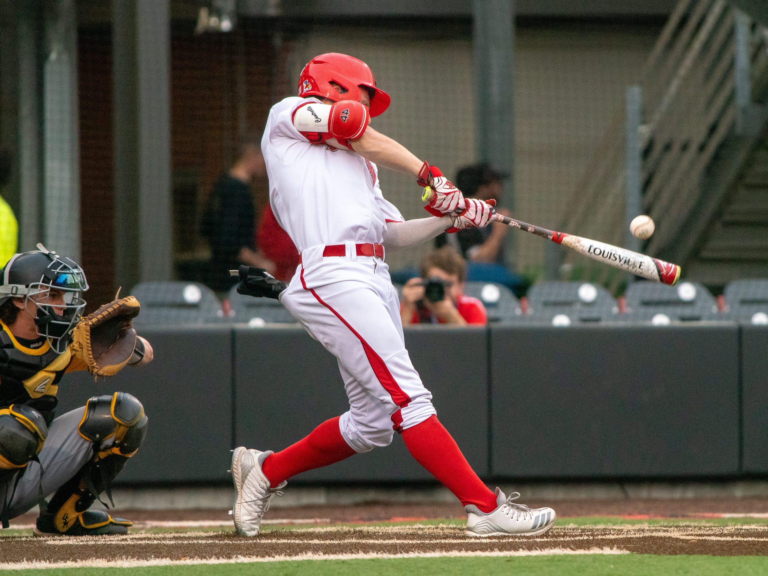 """UL's Hayden Cantrelle hits the incoming pitch as the Ragin' Cajuns take on the Southern Miss Golden Eagles at M.L. """"Tigue"""" Moore Field on Wednesday, March 13, 2019."""