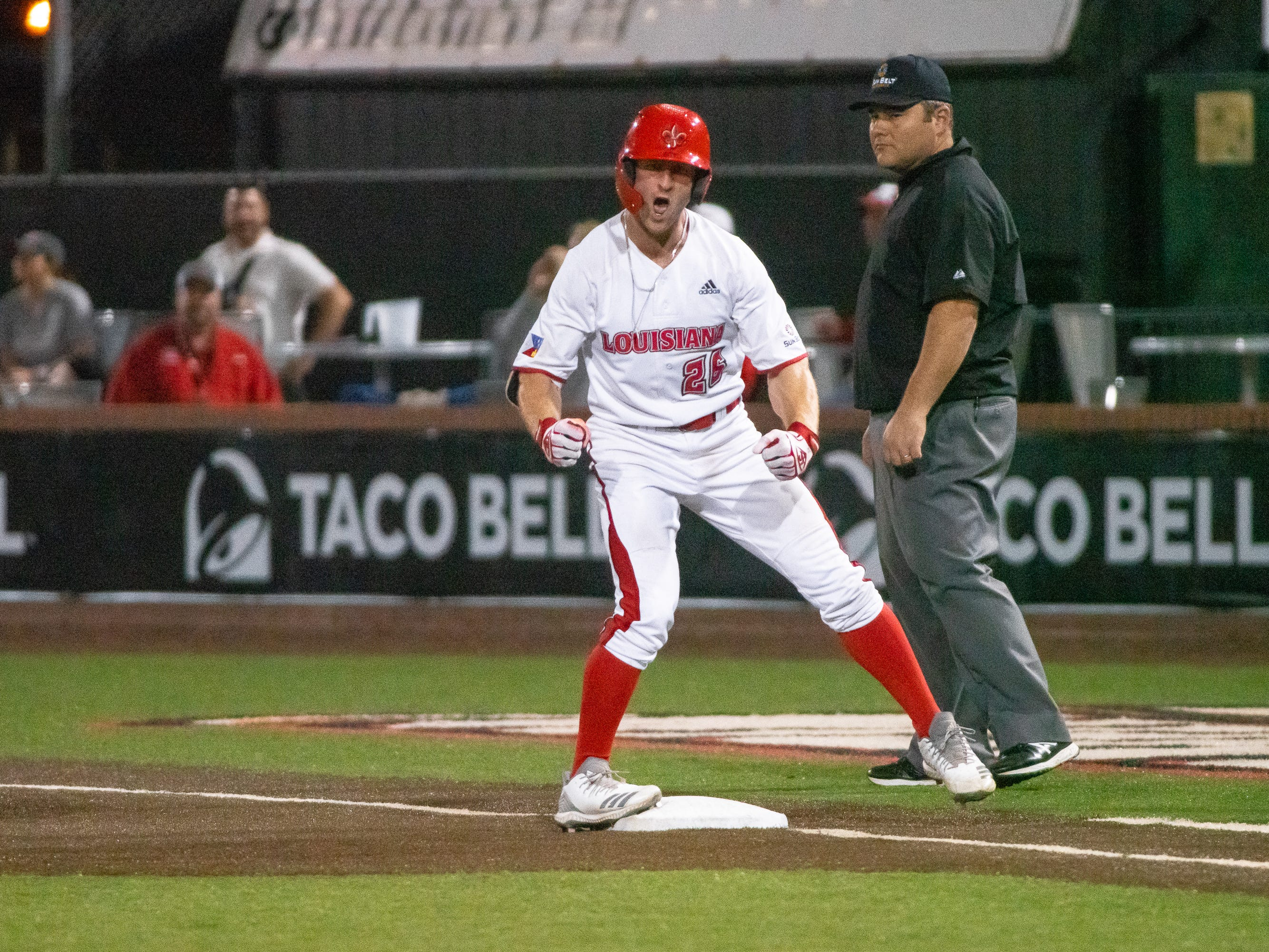 """UL's Daniel Lahare celebrates his hit on first base as the Ragin' Cajuns take on the Southern Miss Golden Eagles at M.L. """"Tigue"""" Moore Field on Wednesday, March 13, 2019."""