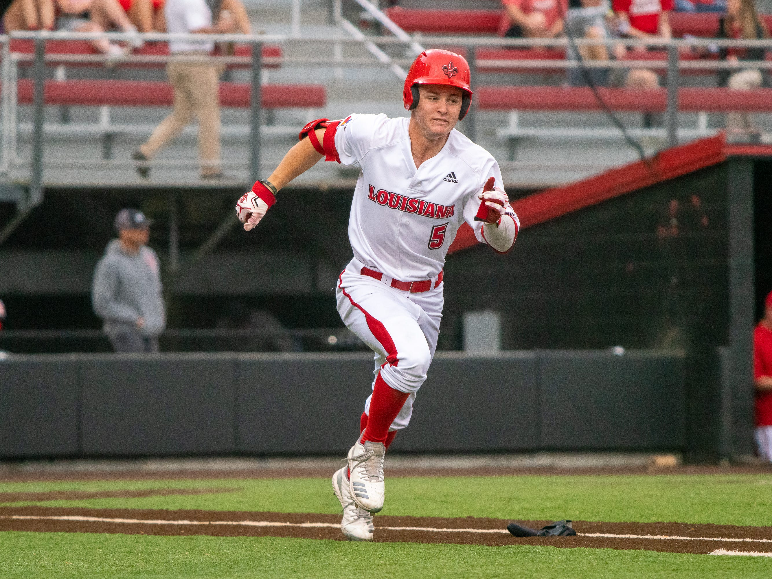 """UL's Hayden Cantrelle rushes to first base as the Ragin' Cajuns take on the Southern Miss Golden Eagles at M.L. """"Tigue"""" Moore Field on Wednesday, March 13, 2019."""