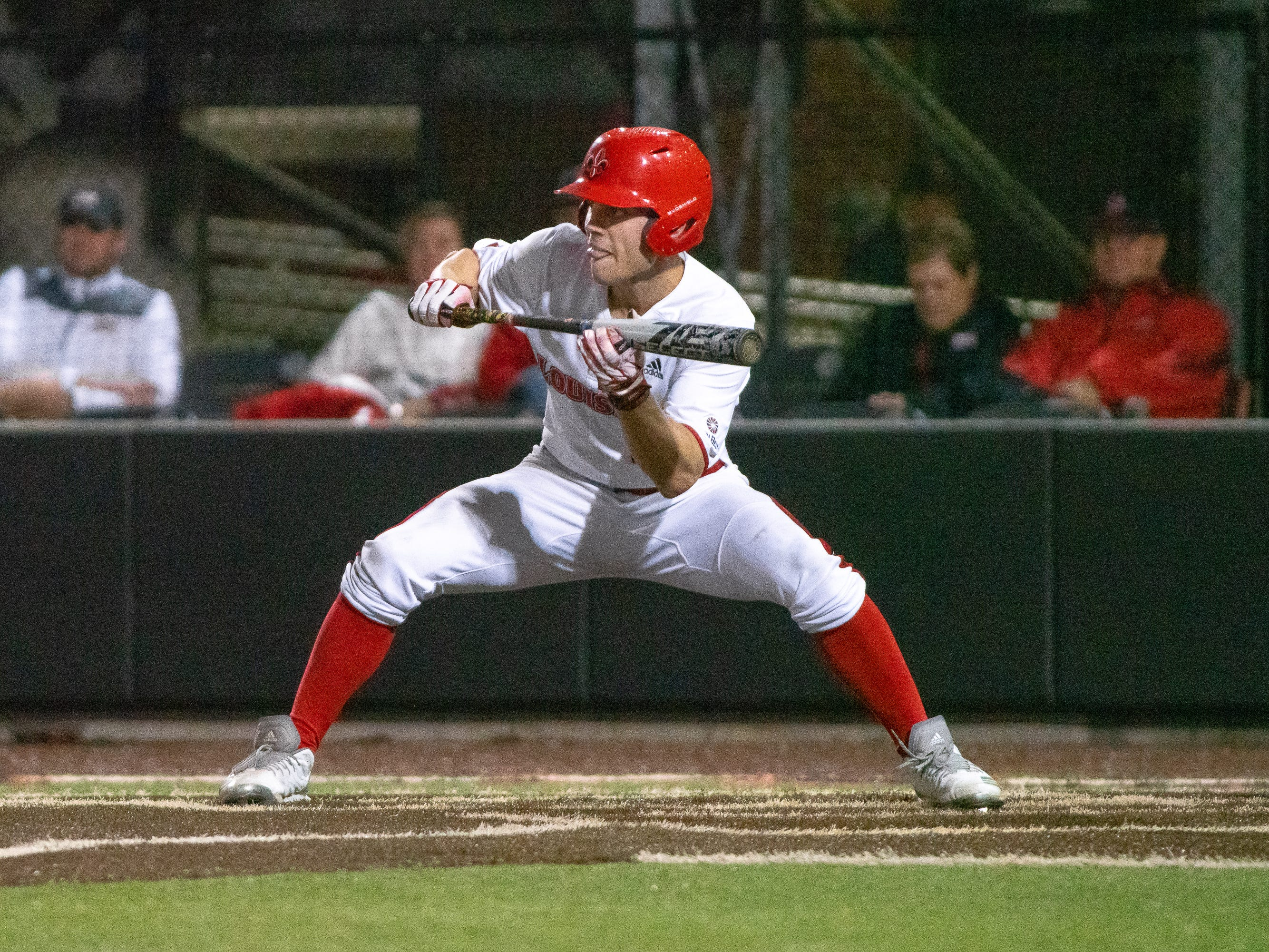 """UL's Hunter Kasuls prepares to bunt the ball as the Ragin' Cajuns take on the Southern Miss Golden Eagles at M.L. """"Tigue"""" Moore Field on Wednesday, March 13, 2019."""