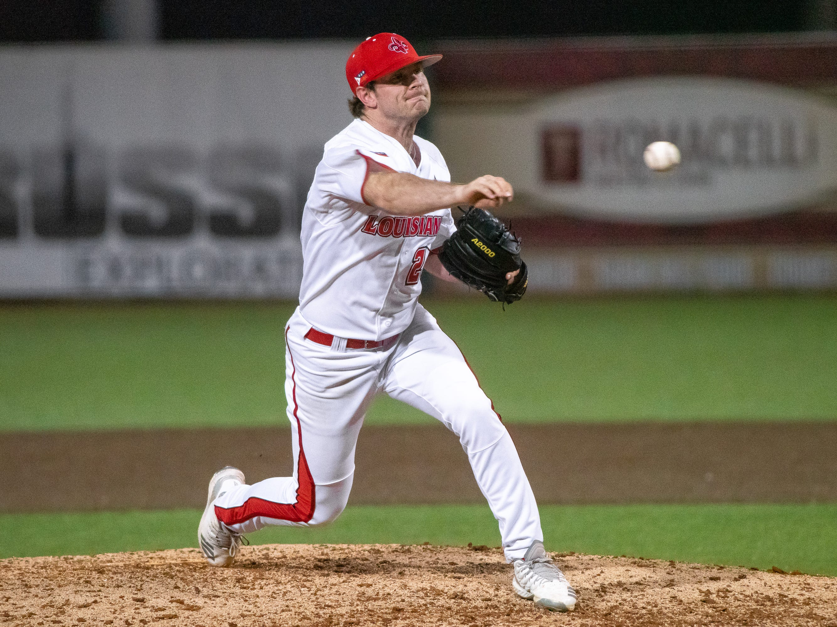 """UL's pitcher Caleb Armstrong throws the ball from the mound as the Ragin' Cajuns take on the Southern Miss Golden Eagles at M.L. """"Tigue"""" Moore Field on Wednesday, March 13, 2019."""