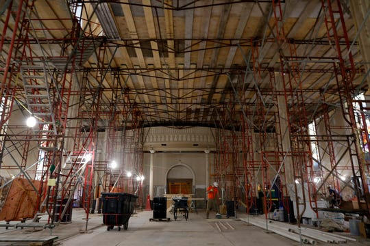 Standing under a lattice work of scaffolding, supports and wooden planks, a worker sweeps the sanctuary floor of St. Mary of the Assumption Roman Catholic Church Thursday, March 14, 2019, in downtown Lancaster. The scaffolding, wood planks and supports form a sort of second floor inside the sanctuary for more scaffolding and ladders that allow workers to repair and repaint the ceiling. The interior of the church's sanctuary is undergoing on a months-long renovation that also includes refinishing the pews and new wainscoting.