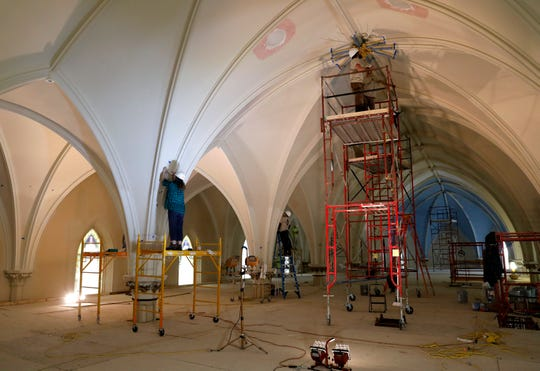 Muralworks employees do preliminary work on the ceiling of St. Mary of the Assumption Roman Catholic Church Thursday, March 14, 2019, in downtown Lancaster. The church's sanctuary is currently undergoing extensive renovations including the painting of the 60-foot high ceiling.