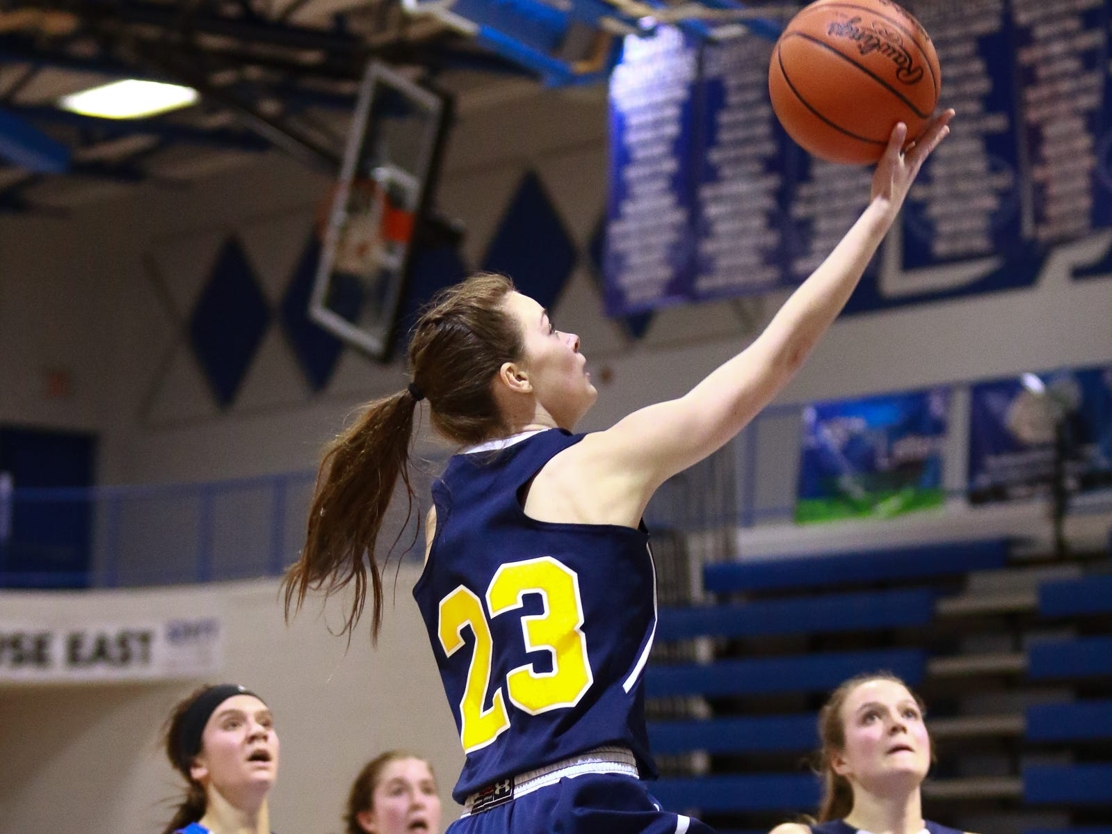 Hartland's Gracey Metz drives to the basket in a 50-46 victory over Walled Lake Western in the Division 1 regional championship game at Lakeland on Wednesday, March 13, 2019.