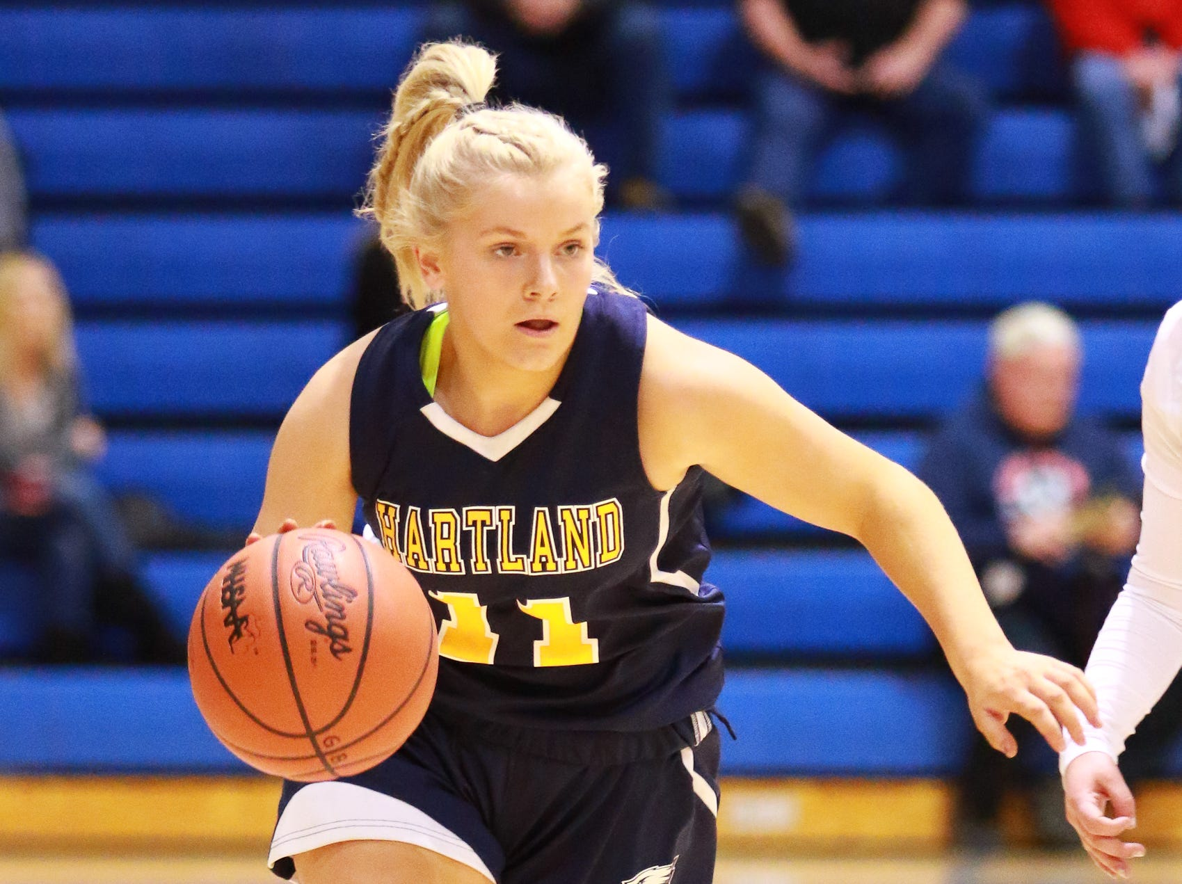 Hartland's Amanda Roach brings the ball up the floor in a 50-46 victory over Walled Lake Western in a regional championship basketball game at Lakeland on Wednesday, March 13, 2019.