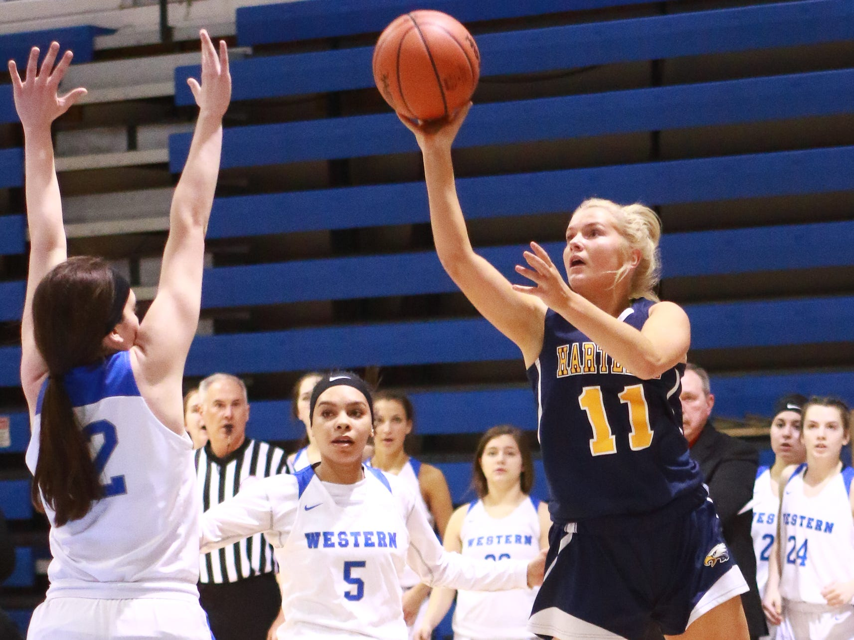 Hartland's Amanda Roach takes a one-handed shot in a 50-46 victory over Walled Lake Western in the Division 1 regional championship game at Lakeland on Wednesday, March 13, 2019.