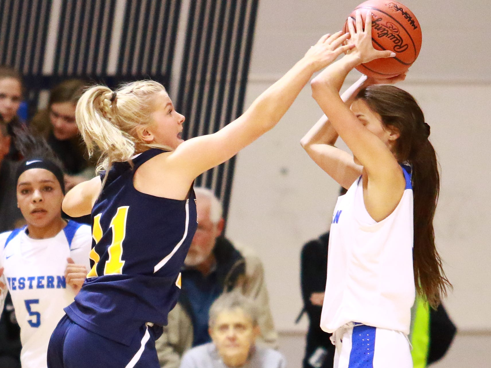 Hartland's Amanda Roach plays defense in a 50-46 victory over Walled Lake Western in a regional championship basketball game at Lakeland on Wednesday, March 13, 2019.