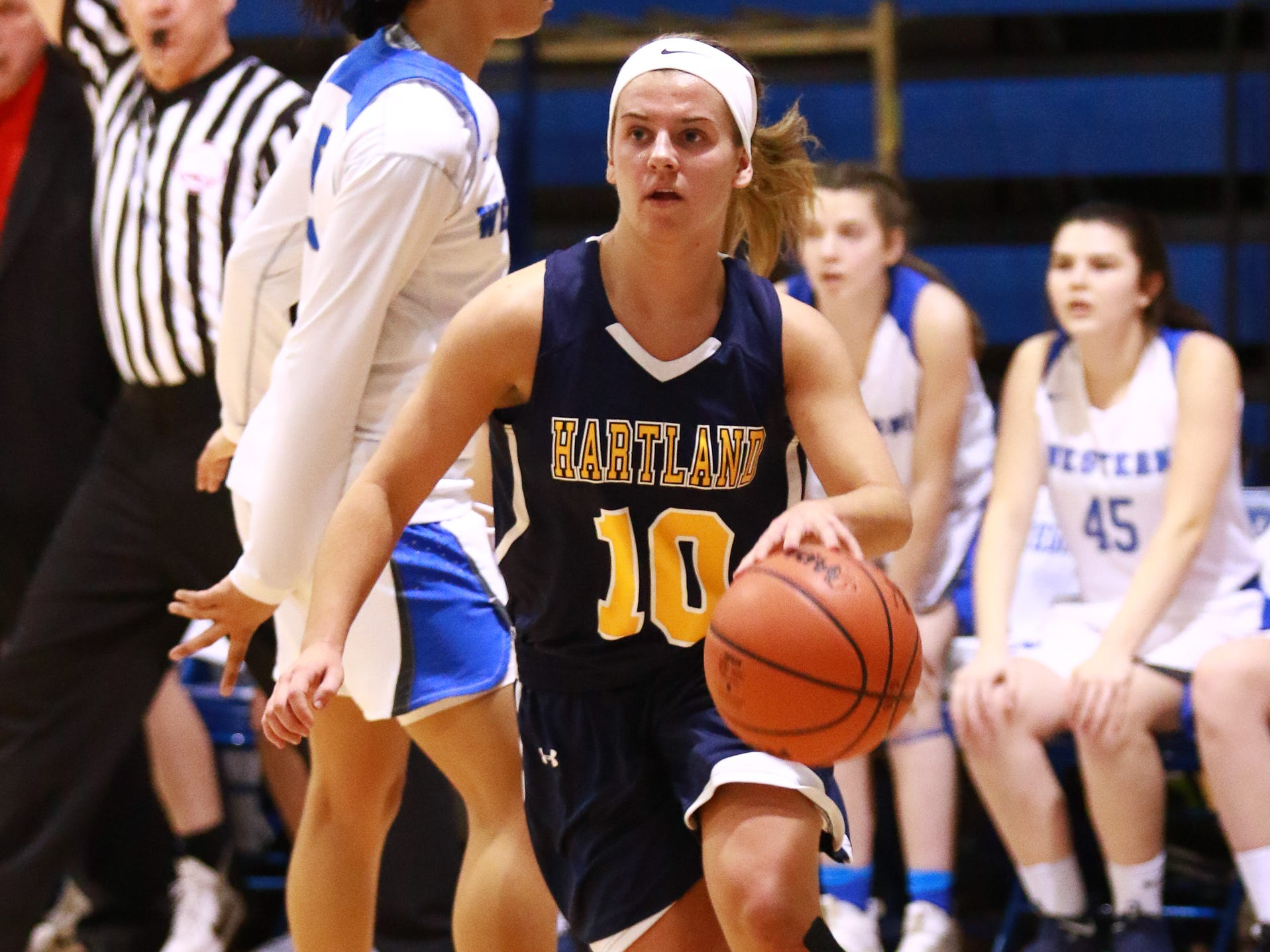 Hartland's Nikki Dompierre, who scored a career-high 26 points, drives the baseline in a 50-46 victory over Walled Lake Western in a regional championship basketball game at Lakeland on Wednesday, March 13, 2019.