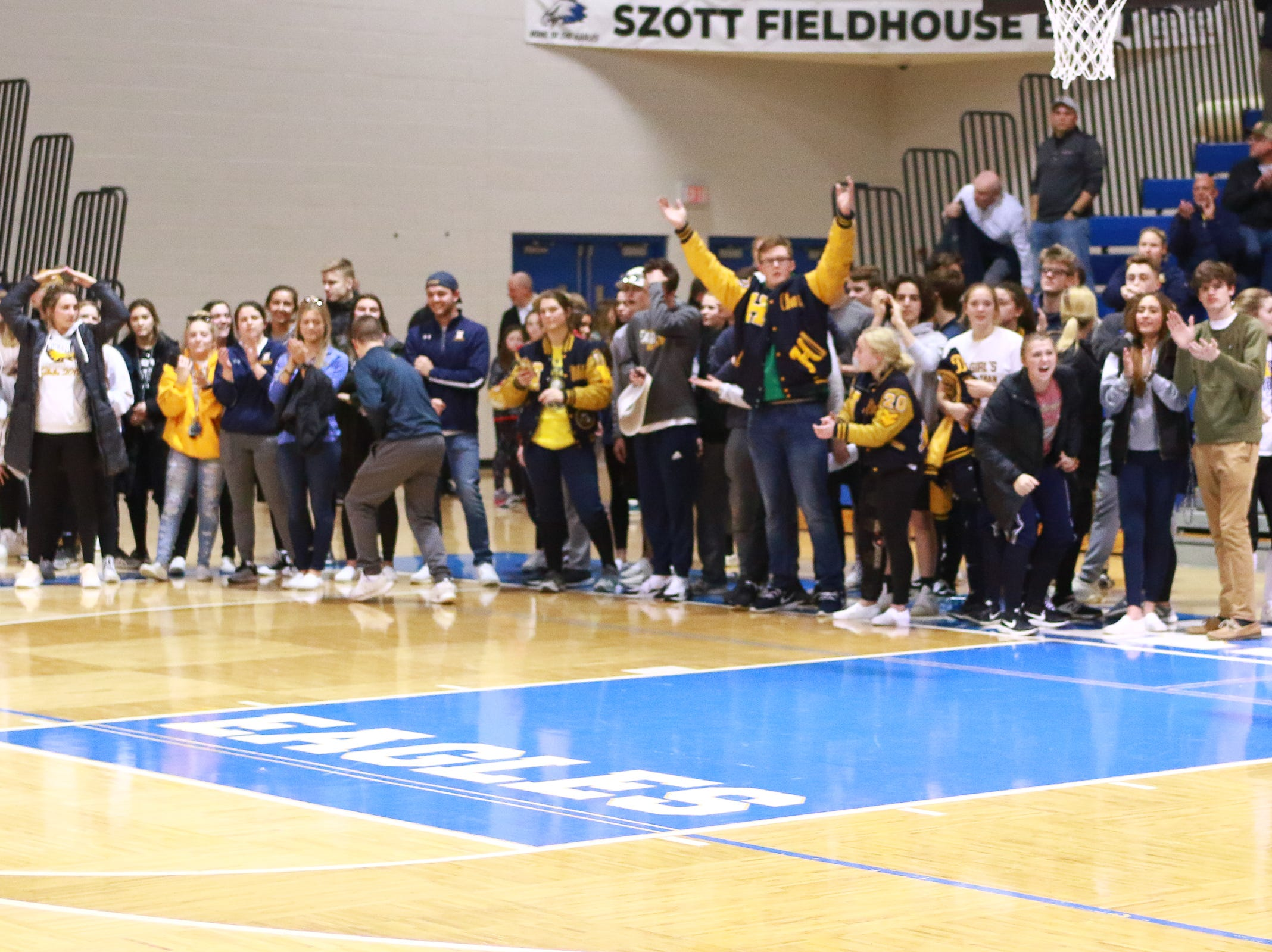 Hartland's student section celebrates a 50-46 victory over Walled Lake Western in a regional championship basketball game at Lakeland on Wednesday, March 13, 2019.