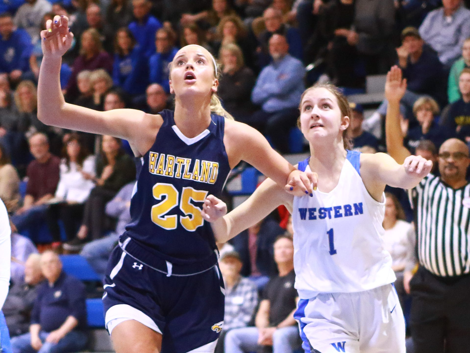 Hartland's Whitney Sollom (25) boxes out Walled Lake Western's Zoe DeRoche in the Eagles' 50-46 victory in the Division 1 regional championship game at Lakeland on Wednesday, March 13, 2019.