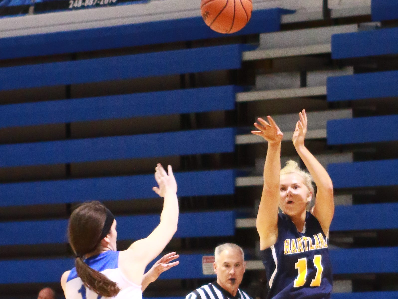 Hartland's Amanda Roach launches a 3-point attempt in a 50-46 victory over Walled Lake Western in a regional championship basketball game at Lakeland on Wednesday, March 13, 2019.