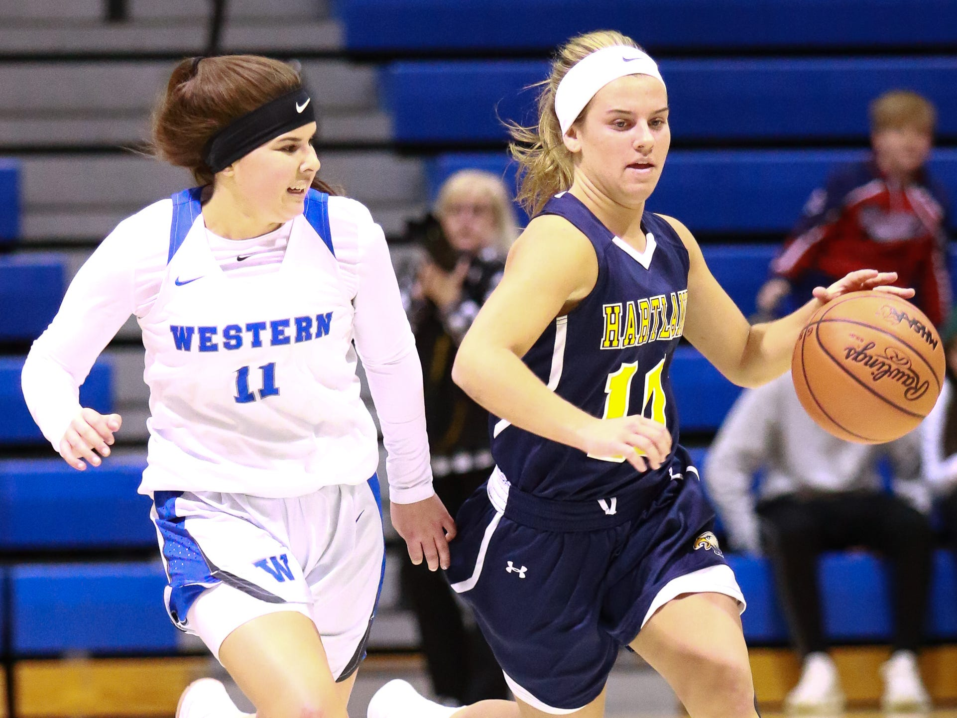 Hartland's Nikki Dompierre (right) scored a career-high 26 points in a 50-46 victory over Walled Lake Western in the Division 1 regional championship game at Lakeland on Wednesday, March 13, 2019.