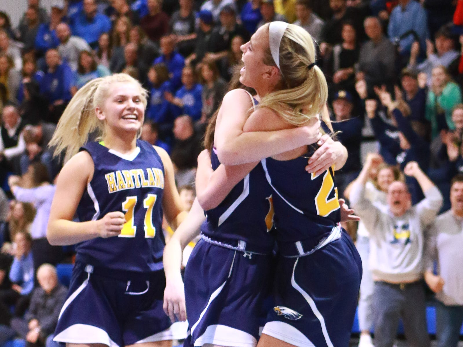 Whitney Sollom (right) celebrates after being fouled while making a basket late in a 50-46 victory over Walled Lake Western in a regional championship basketball game at Lakeland on Wednesday, March 13, 2019.