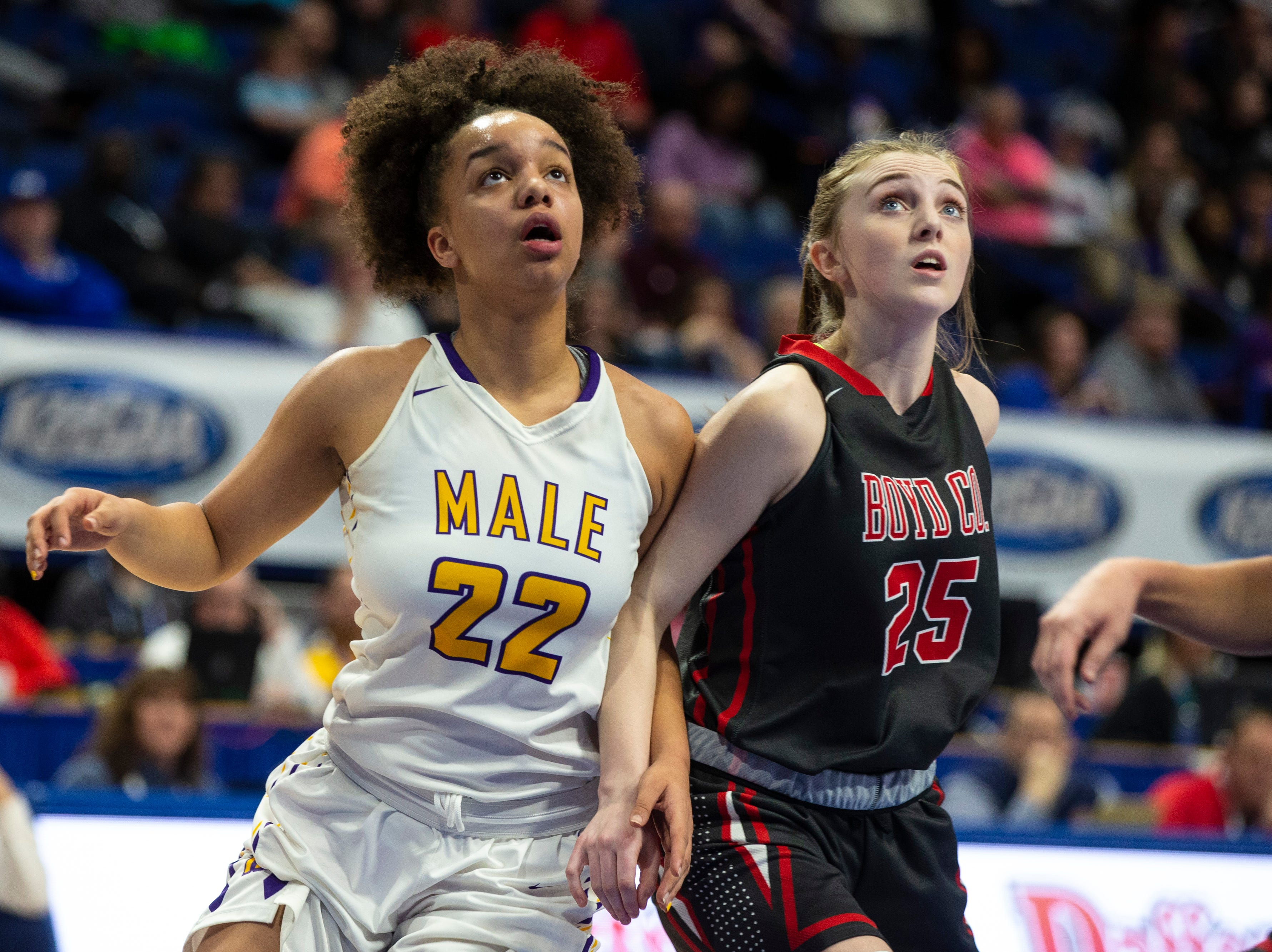Male's Alana Stiverson, left, looks to block out Boyd County's Olivia Parsons in the first quarter as Boyd County took on Louisville Male in the KHSAA state basketball tournament in Rupp Arena. Male eliminated Boyd County 74-56. March 14, 2019
