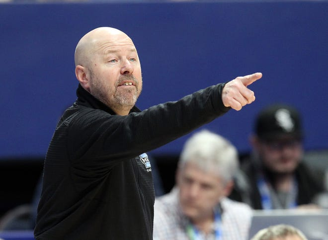 Mercy head coach Keith Baisch directs his team in their opening round game against George Rogers Clark at the KHSAA Girl's Sweet 16, Wednesday, March 13. George Rogers Clark won 65-64.