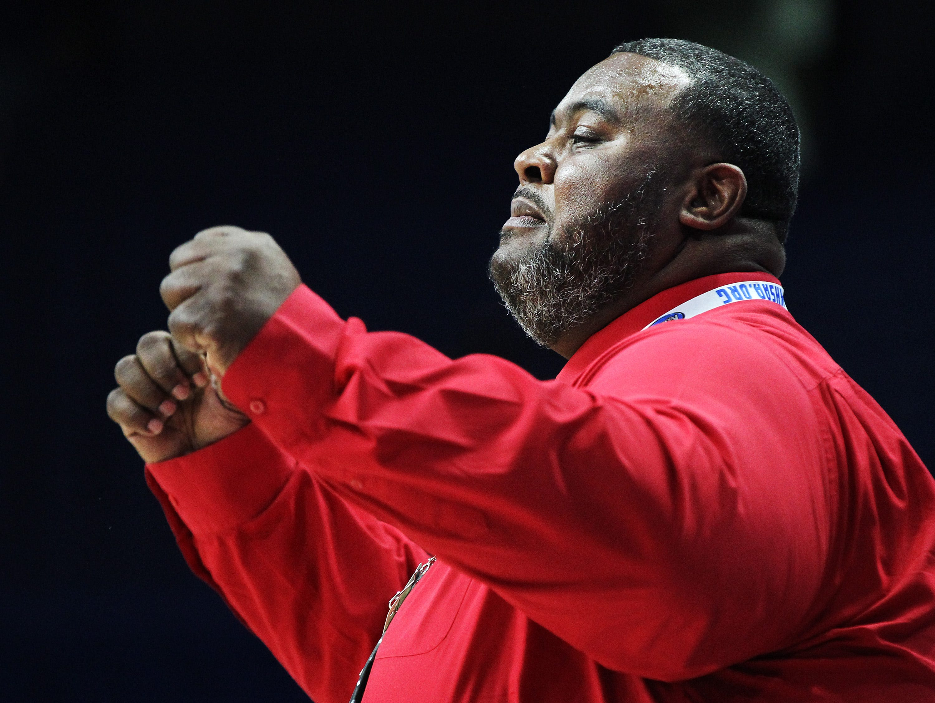 George Rogers Clark head coach Robbie Graham directs his team in their opening round game against Mercy at the KHSAA Girl's Sweet 16, Wednesday, March 13. George Rogers Clark won 65-64.