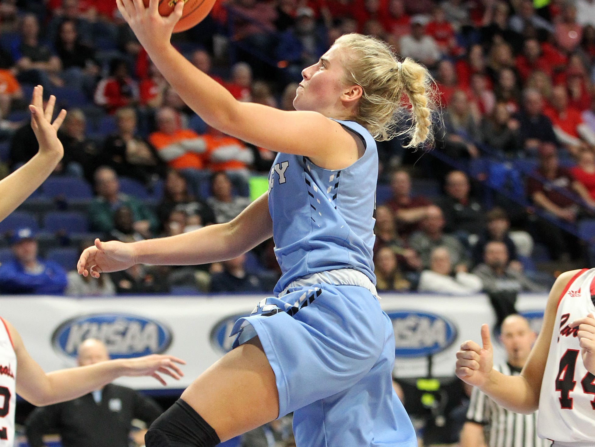 Mercy's Hope Sivori shoots between George Rogers Clark defenders in their opening round game at the KHSAA Girl's Sweet 16, Wednesday, March 13. George Rogers Clark won 65-64.