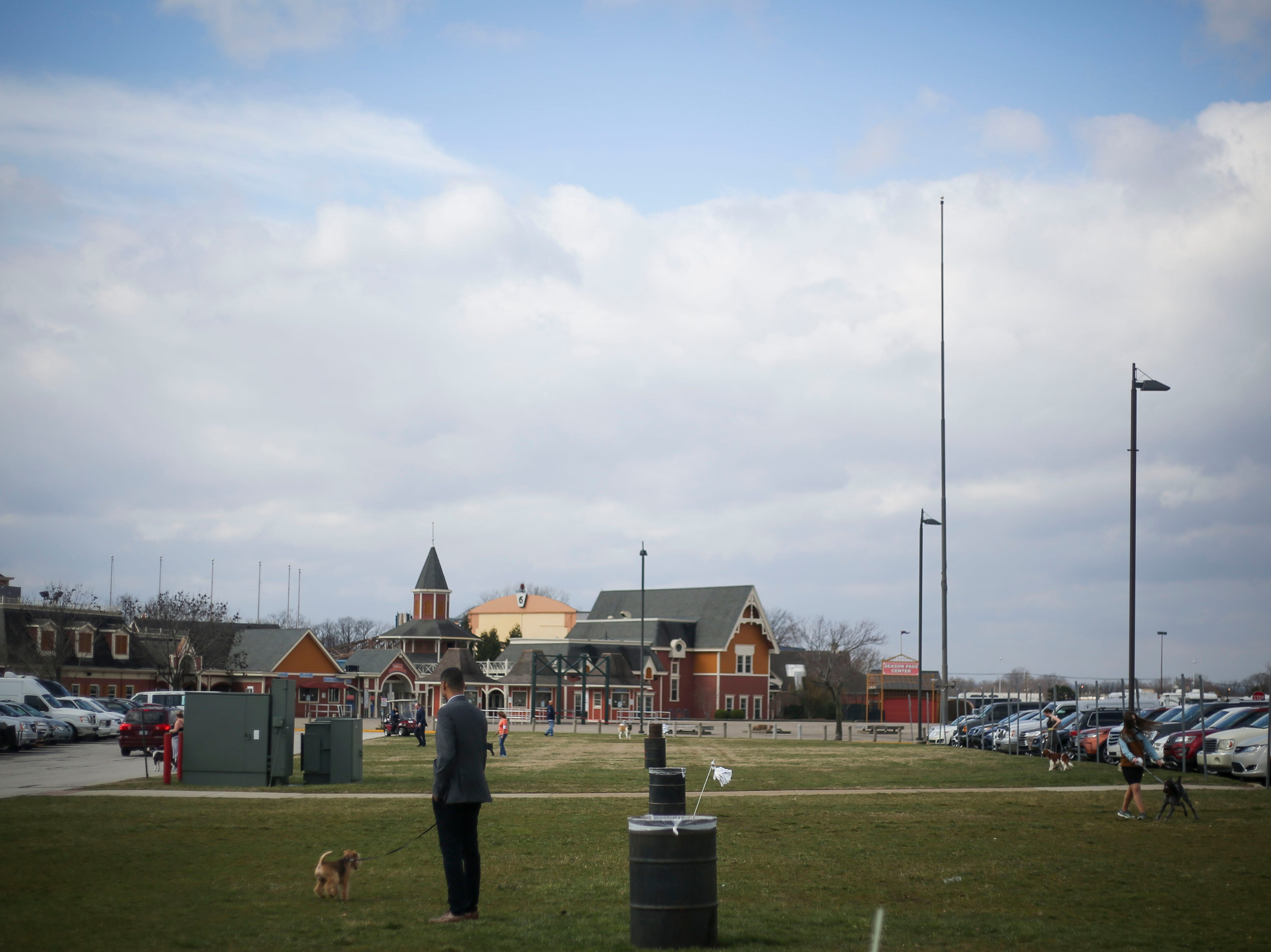 Handlers and owners walk their dogs outside during the Kentuckiana Cluster of Dog Shows at the Kentucky Fair and Exposition Center in Louisville, Ky. on Thursday, March 14, 2019.